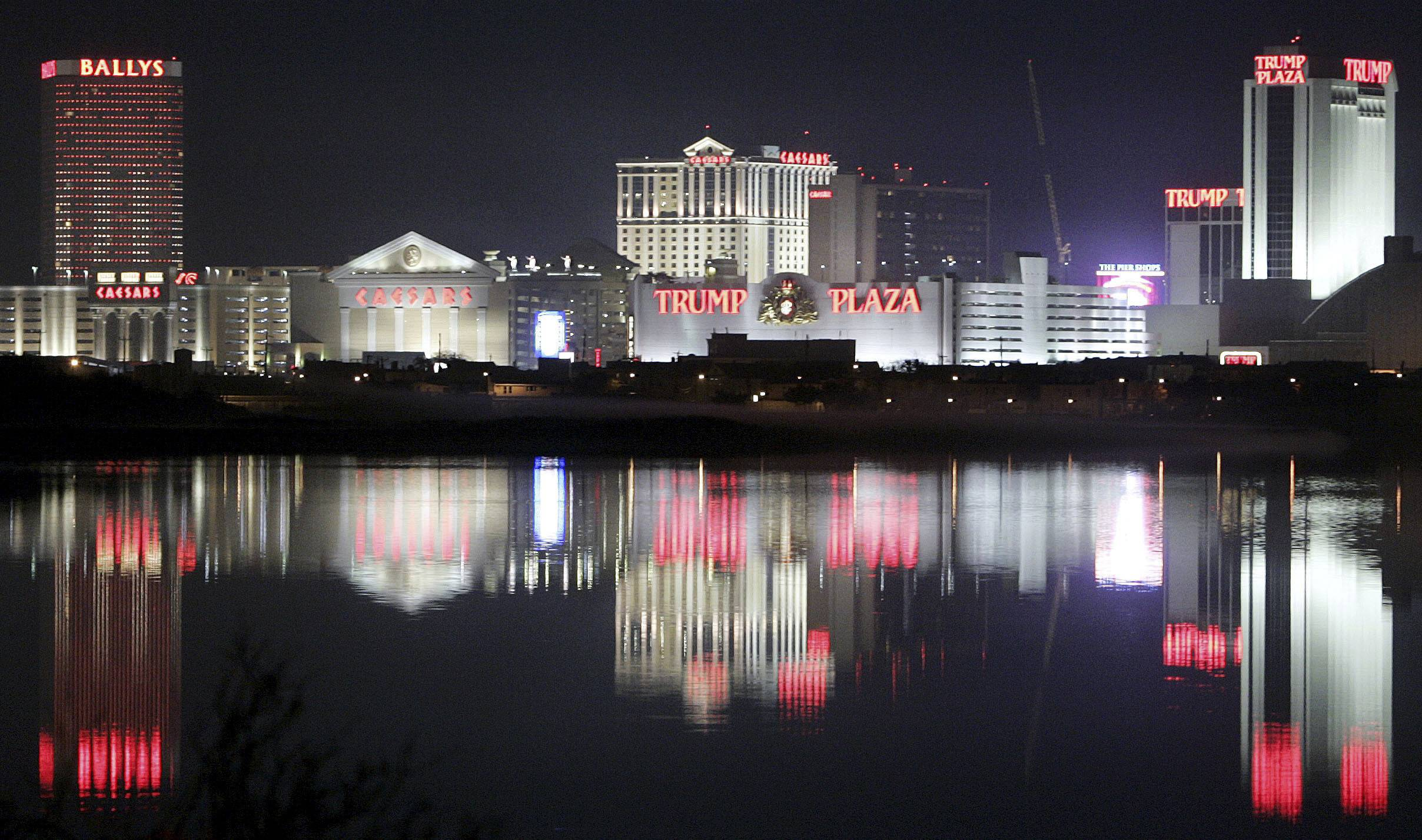 Hotels and casinos in Atlantic City, N.J. are reflected in the water early in the morning. Now that the shock over the prospect of losing three Atlantic City casinos in the coming months is starting to wear off, many workers and their union are mounting a growing effort to keep them open by attracting new bidders and offering flexibility in contract negotiations with any potential buyer.