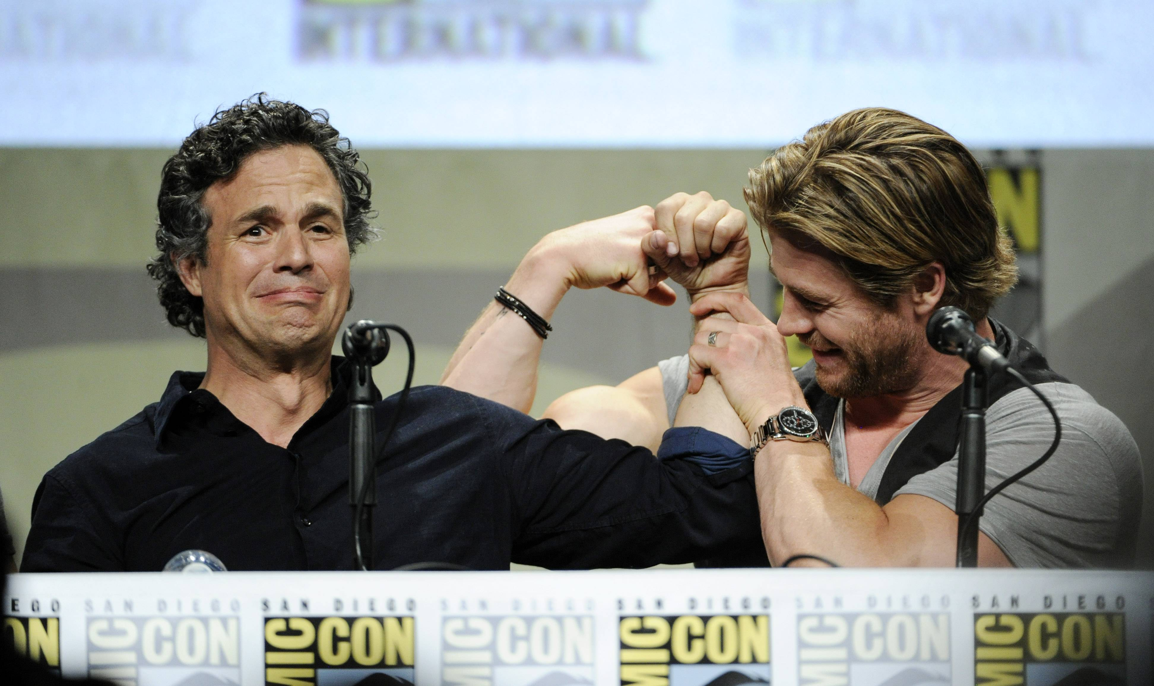 Actors Mark Ruffalo, left, and Chris Hemsworth compare biceps during the Marvel panel at Comic-Con International on Saturday in San Diego, Calif.