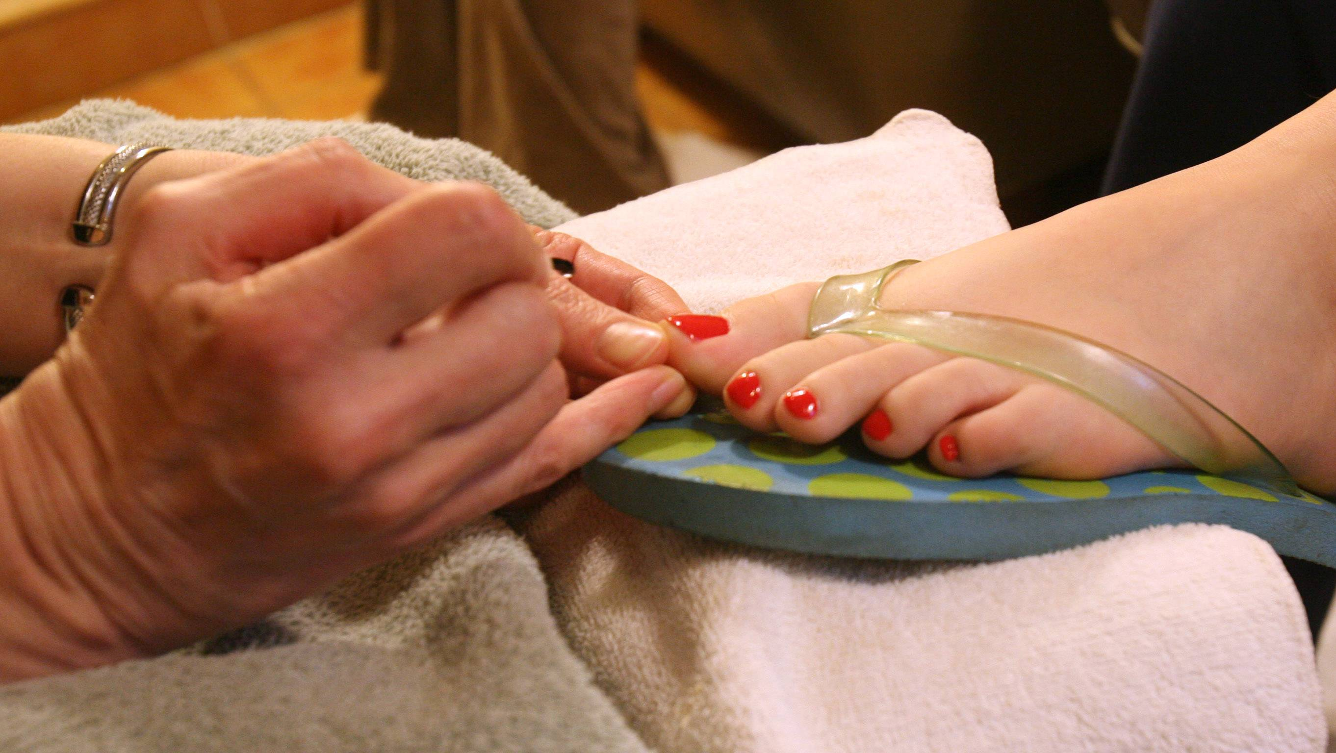 Getting a pedicure for colorful toes can pose some health risks, so doctors warn to be careful.