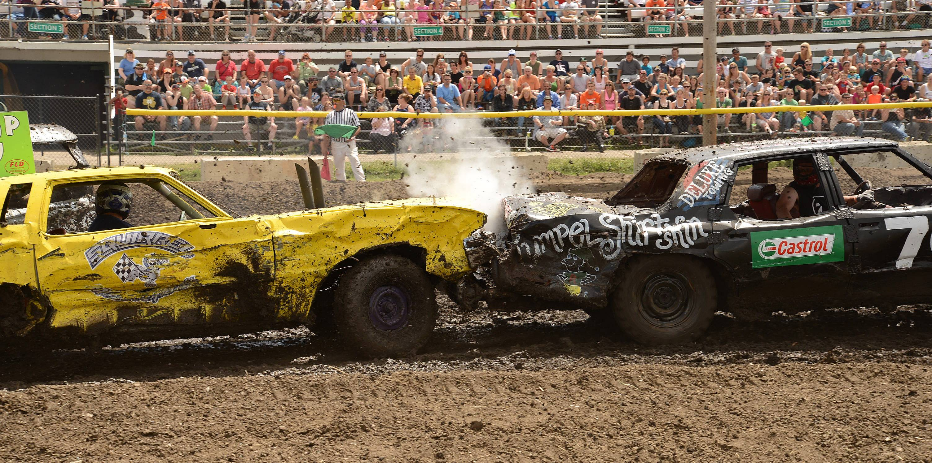 Jay Oppenheim of Wheaton, right, puts a hit on Patrick Wyller, also of Wheaton, Sunday during the demolition derby on the final day of the DuPage County Fair.