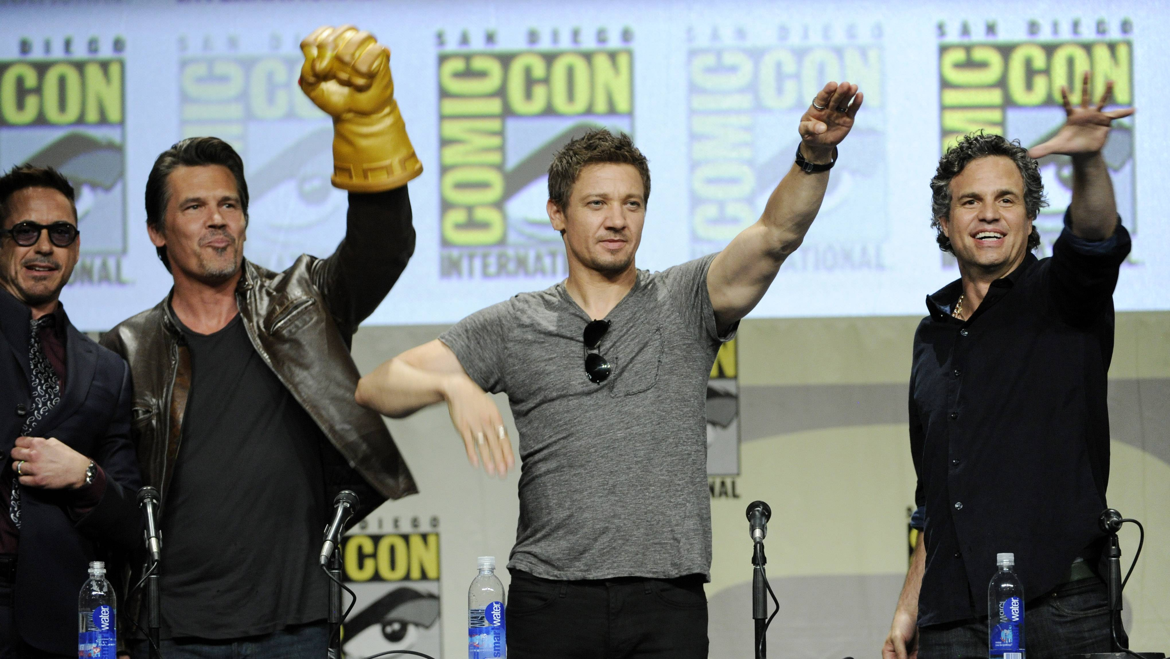 Robert Downey Jr., from left, Josh Brolin, Jeremy Renner and Mark Ruffalo wave to the crowd during the Marvel panel at Comic-Con International on Saturday in San Diego, Calif.
