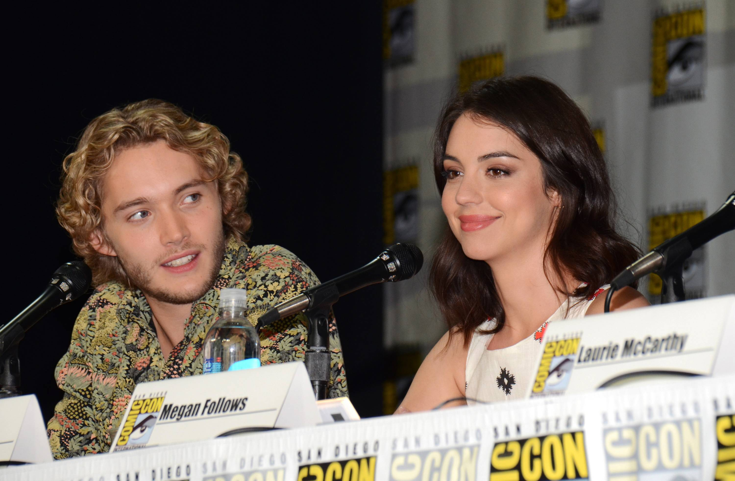 "Toby Regbo, left, and Adelaide Kane attend the ""Reign"" panel on Day 1 of Comic-Con International on Thursday."