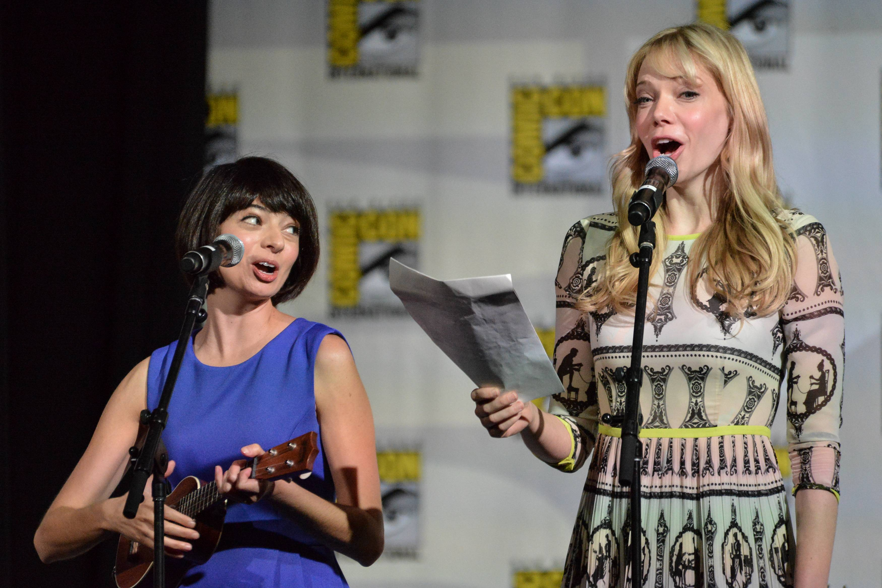 "Kate Micucci, left, and Riki Lindhome perform on stage during the ""The Big Bang Theory"" panel on Day 2 of the Comic-Con International Convention on Friday in San Diego."