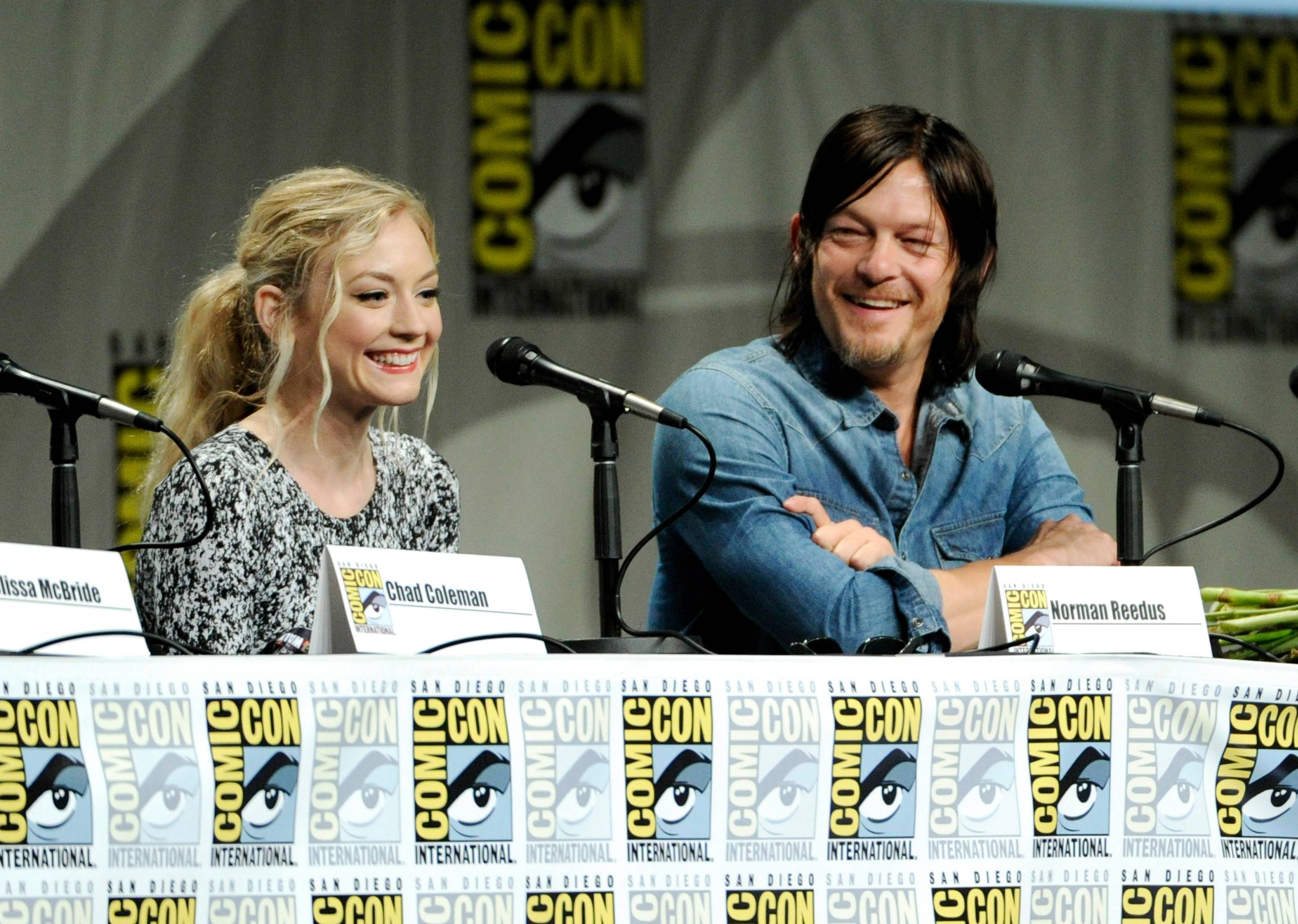"Emily Kinney, left, and Norman Reedus attend ""The Walking Dead"" panel on Day 2 of Comic-Con International on Friday in San Diego. Looking on from left are Chad Coleman and Emily Kinney."