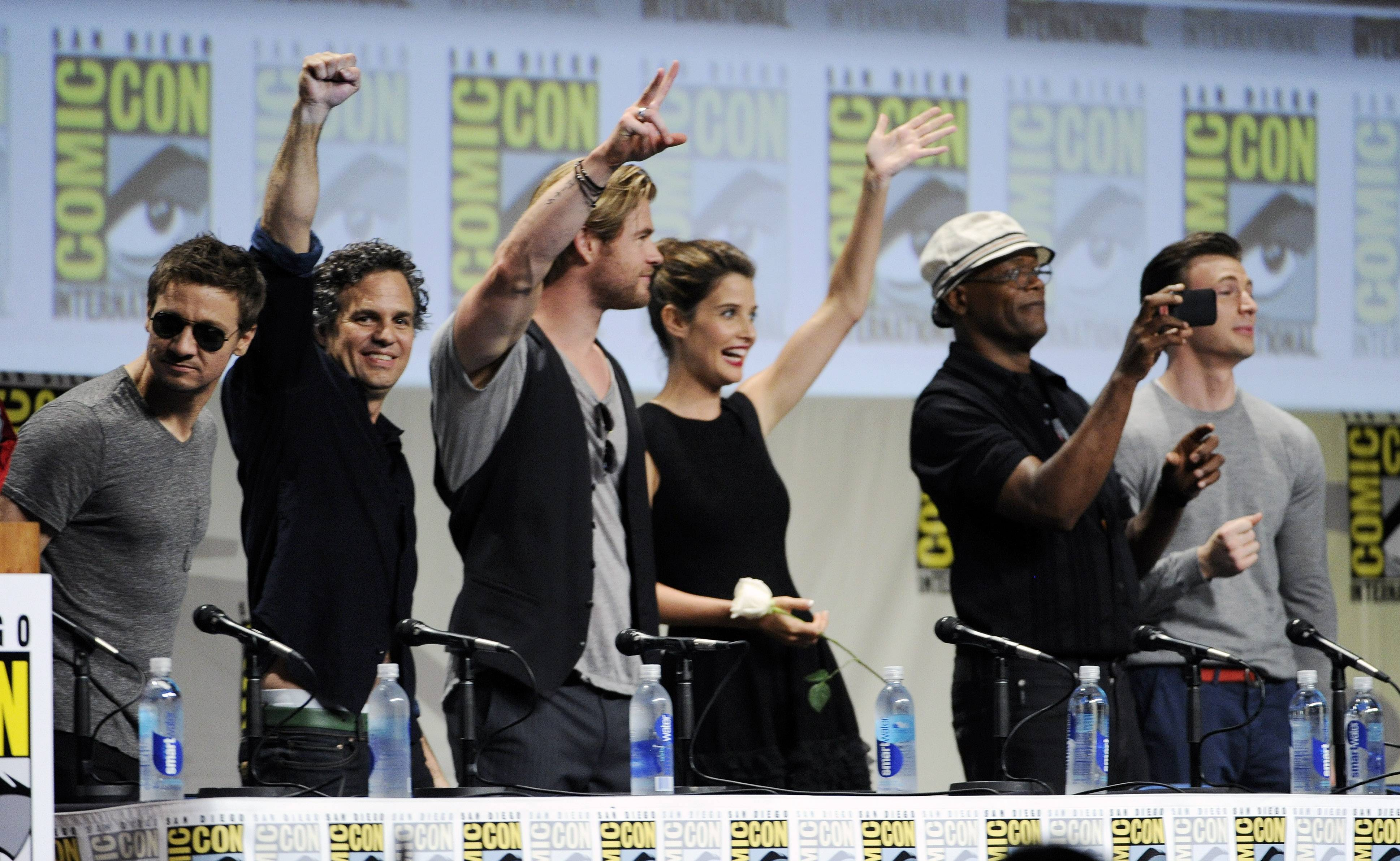 Actors Jeremy Renner, from left, Chris Hemsworth, Cobie Smulders, Samuel L. Jackson and Chris Evans stand during the Marvel panel at Comic-Con International on Saturday in San Diego.