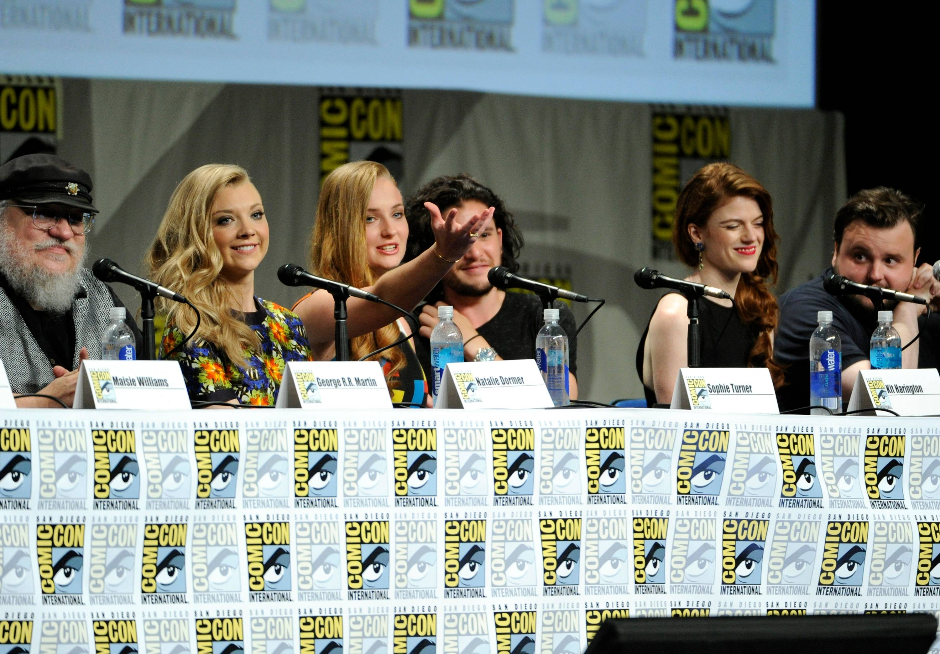 "George R.R. Martin and from left, Natalie Dormer, Sophie Turner, Kit Harington, Rose Leslie and John Bradley attend the ""Game of Thrones"" panel on Day 2 of Comic-Con International on Friday."