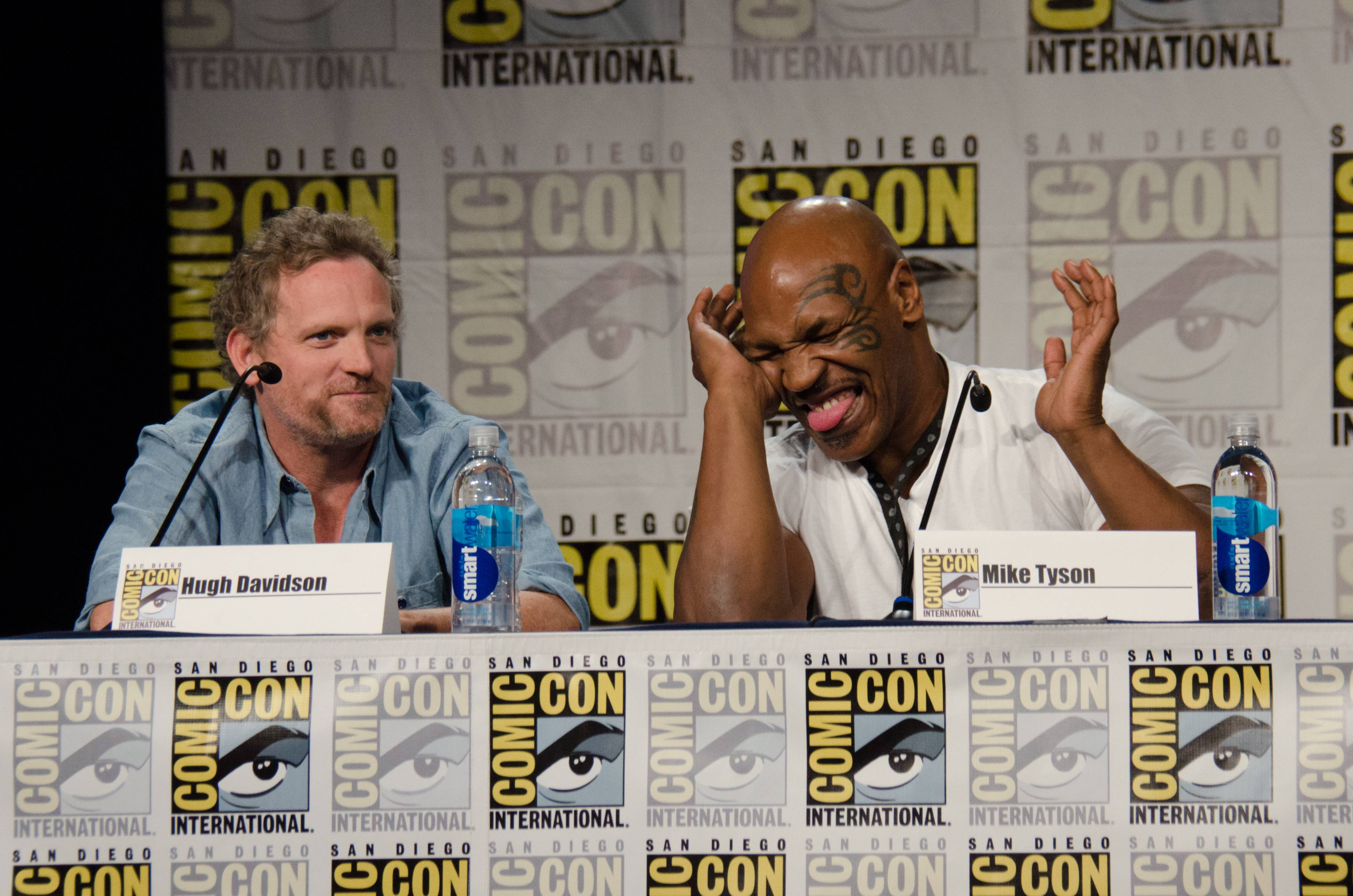 "Hugh Davidson, left, and Mike Tyson attend the ""Mike Tyson Mysteries"" panel on Day 2 of Comic-Con International on Friday."
