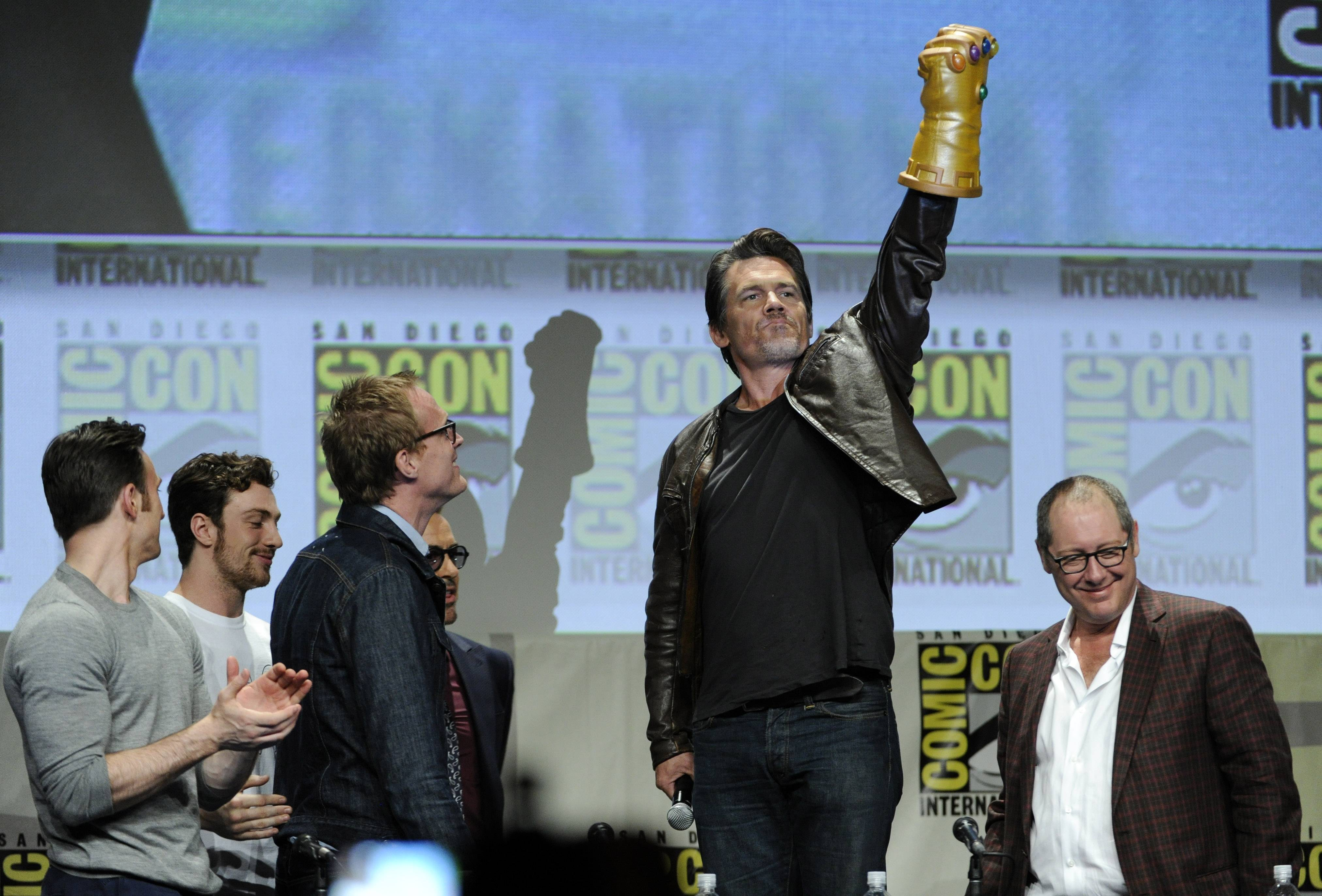 Josh Brolin, second from right, salutes as actors, from left, Chris Evans, Aaron Taylor-Johnson, Paul Bettany and James Spader stand near during the Marvel panel at Comic-Con International on Saturday in San Diego, Calif.
