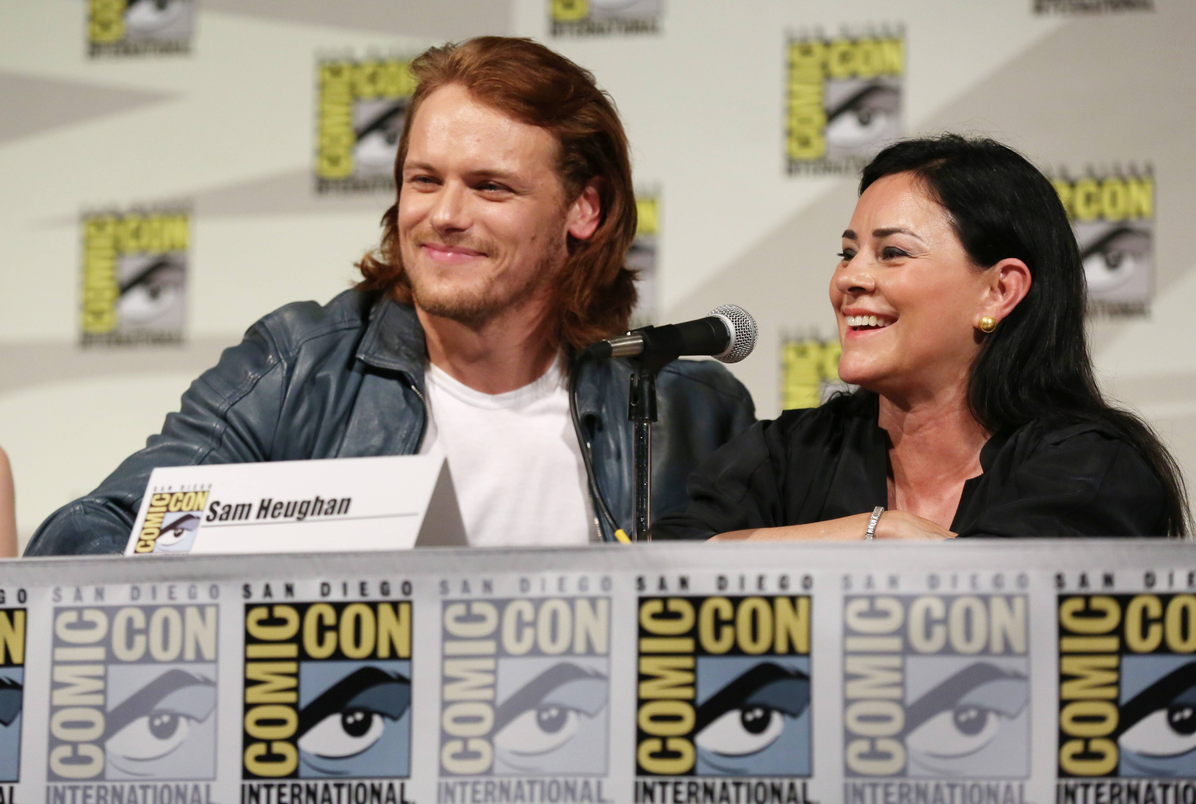 "Sam Heughan, left, and author Diana Gabaldon are seen onstage at the STARZ ""Outlander"" panel during San Diego Comic-Con on Friday, July 25, 2014 in San Diego. ""Outlander"" premieres on STARZ Aug. 9, 2014."