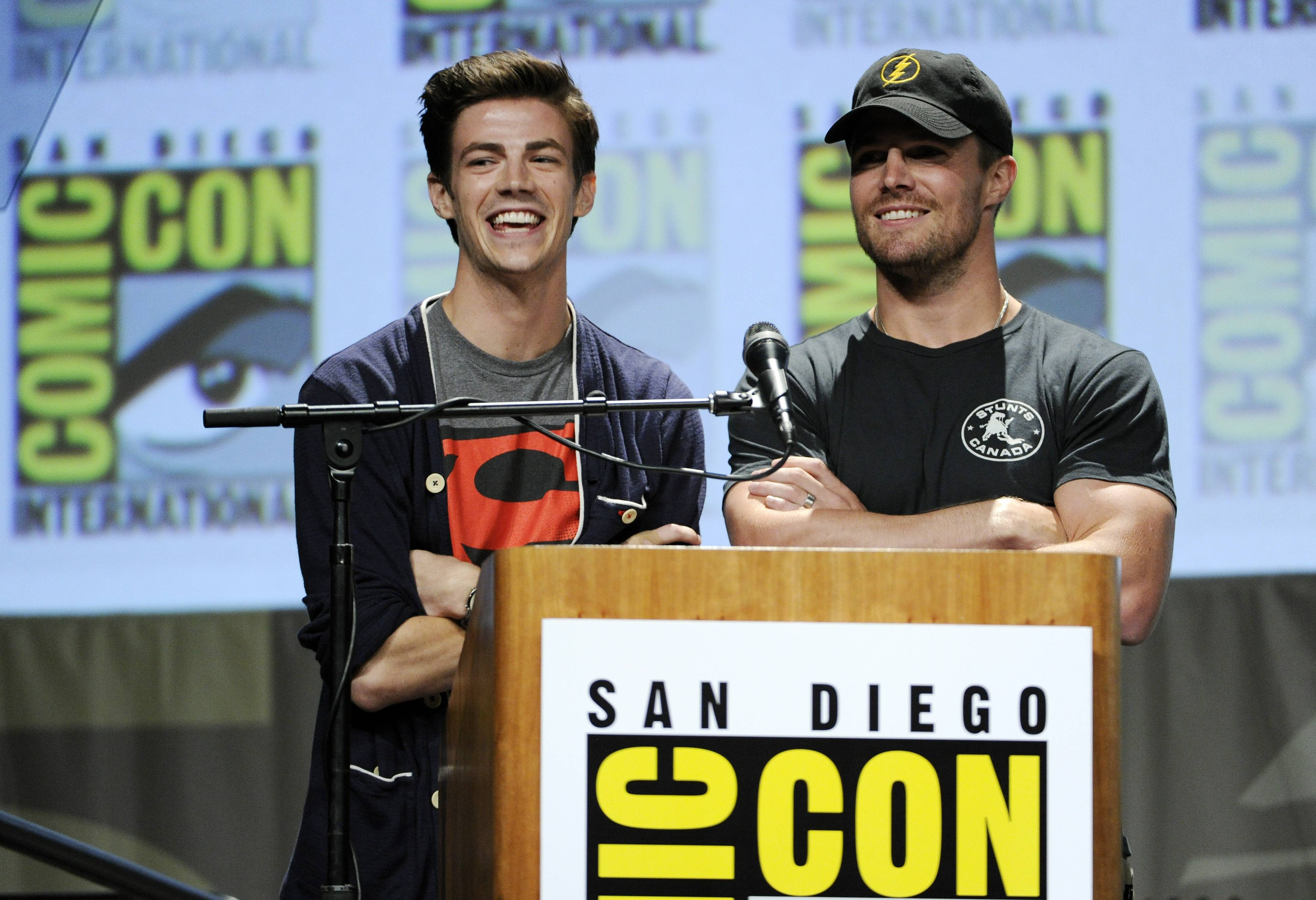 "Grant Gustin, left, a cast member in the television series ""The Flash,"" introduces an episode of the show for the audience as host Stephen Amell stands near at Comic-Con International on Saturday in San Diego."