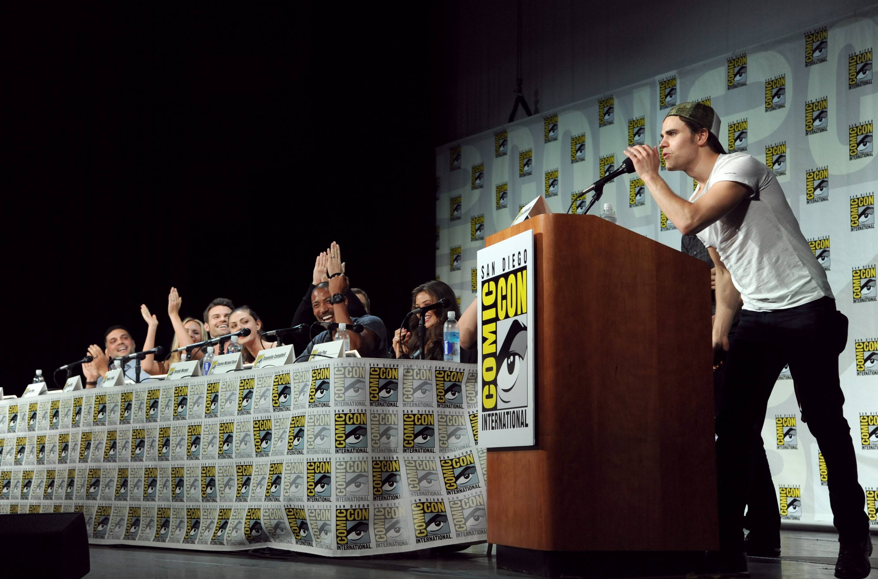 "Michael Narducci and from left, Leah Pipes, Daniel Gillies, Phoebe Tonkin, Joseph Morgan, Charles Michael Davis, Danielle Campbell, and Paul Wesley attend ""The Originals"" panel on Day 2 of Comic-Con International on Friday."