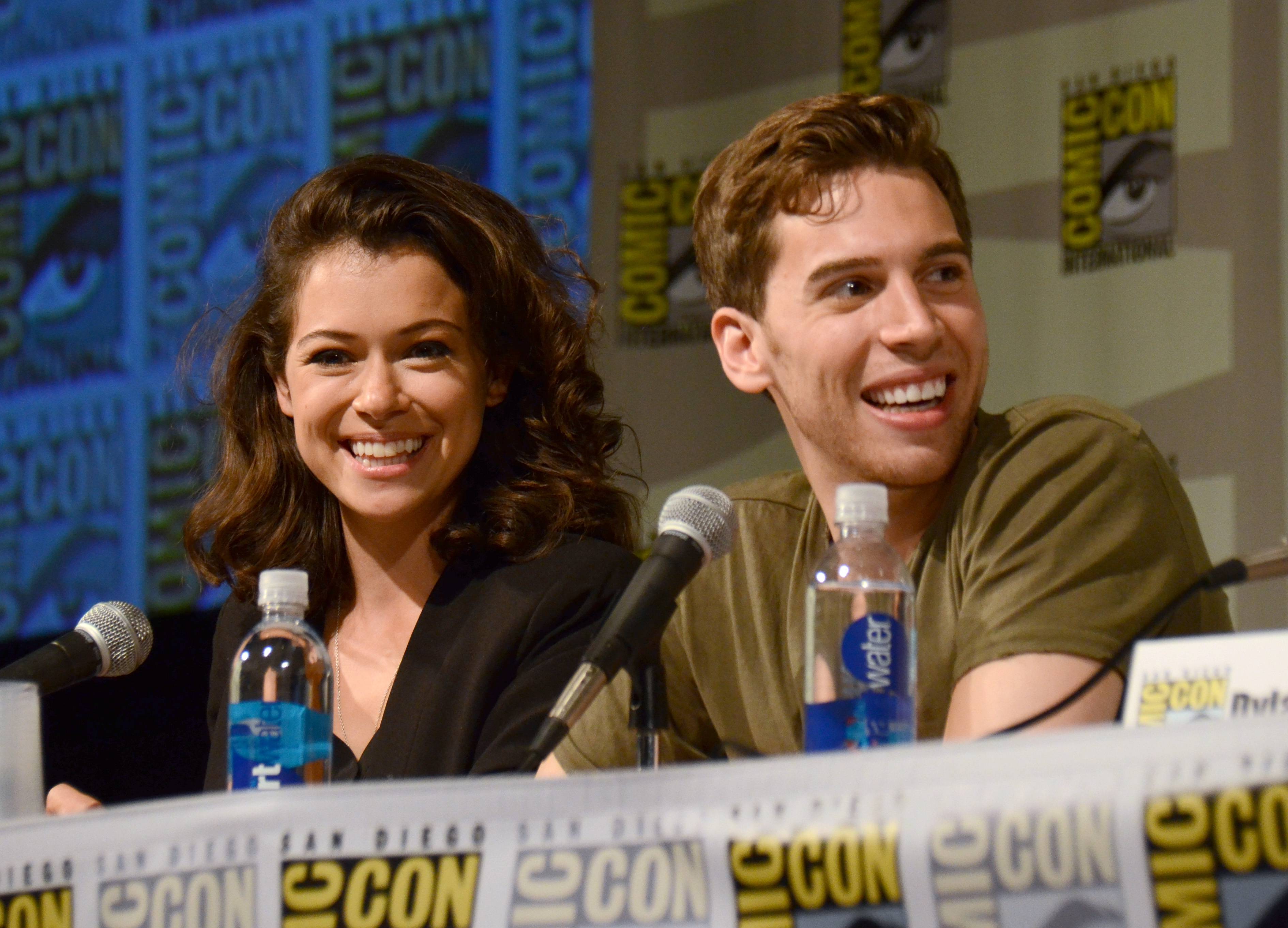 "Tatiana Maslany, left, and Jordan Gavaris attend the ""Orphan Black"" panel on Day 2 of Comic-Con International on Friday."