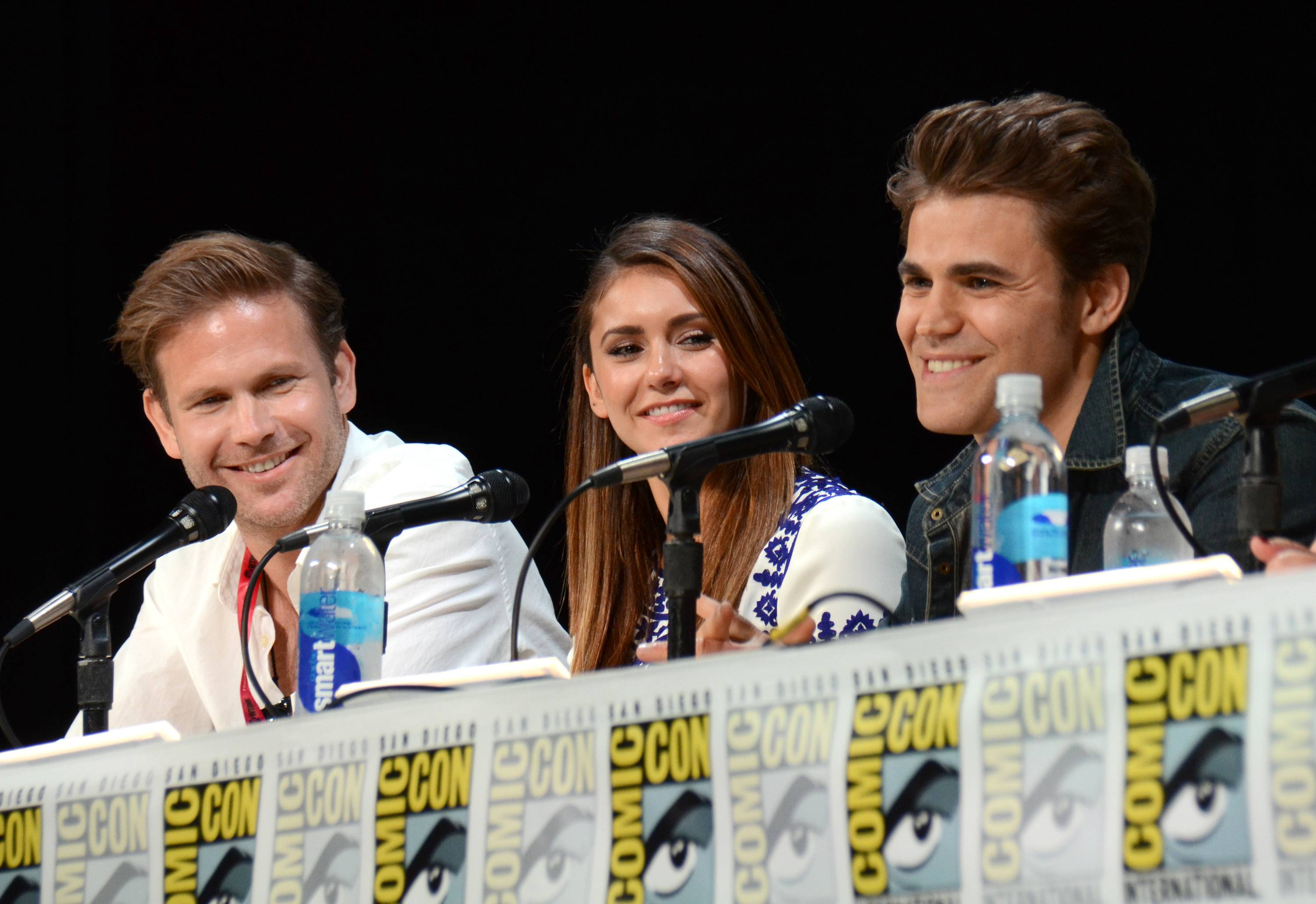 "Matthew Davis, from left, Nina Dobrev and Paul Wesley attend the ""Vampire Diaries"" panel on Day 3 of Comic-Con International on Saturday."