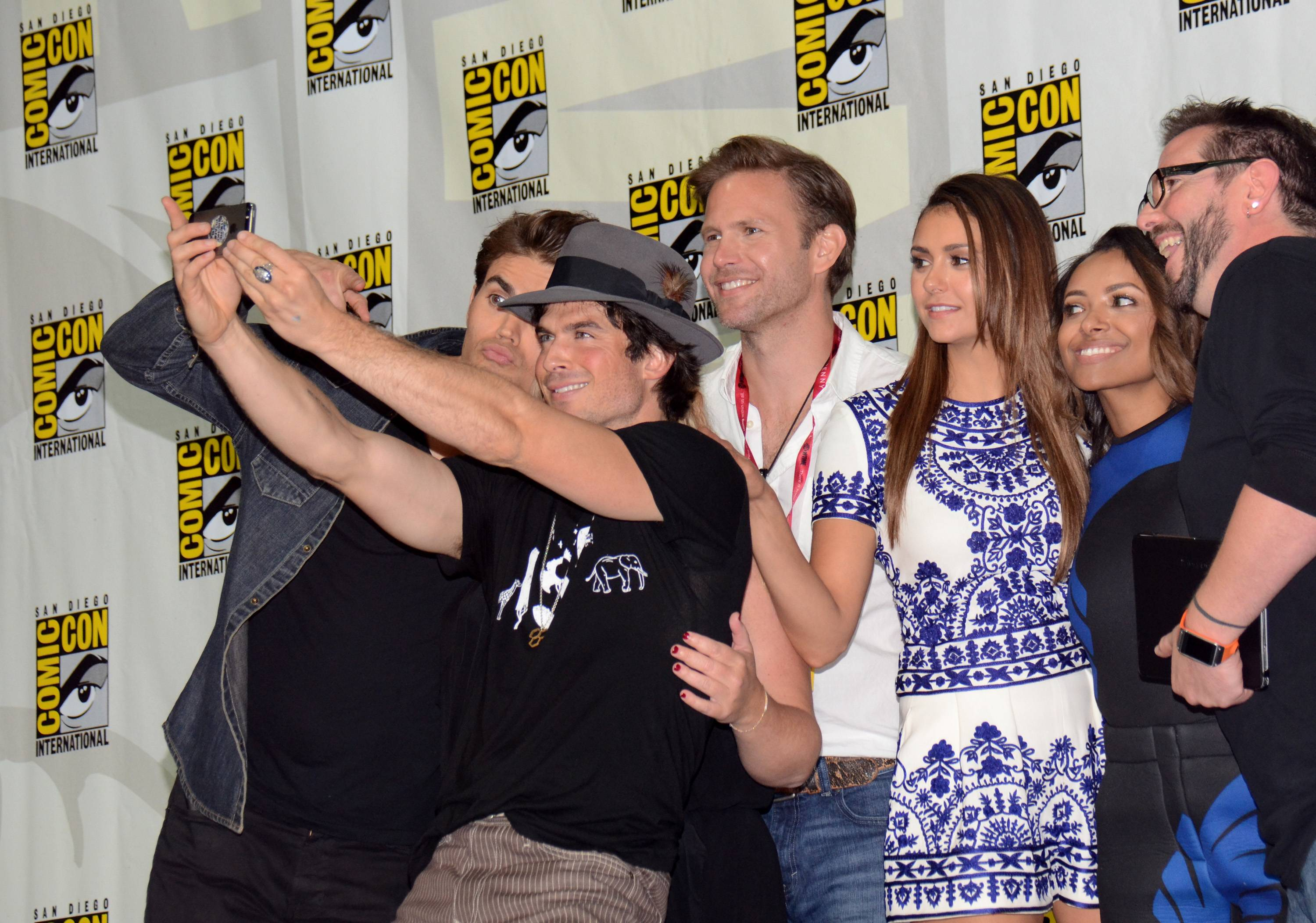 "Paul Wesley, from left, Ian Somerhalder, Matthew Davis, Nina Dobrev, Kat Graham and Damian Holbrook attend the ""Vampire Diaries"" panel on Day 3 of Comic-Con International on Saturday."