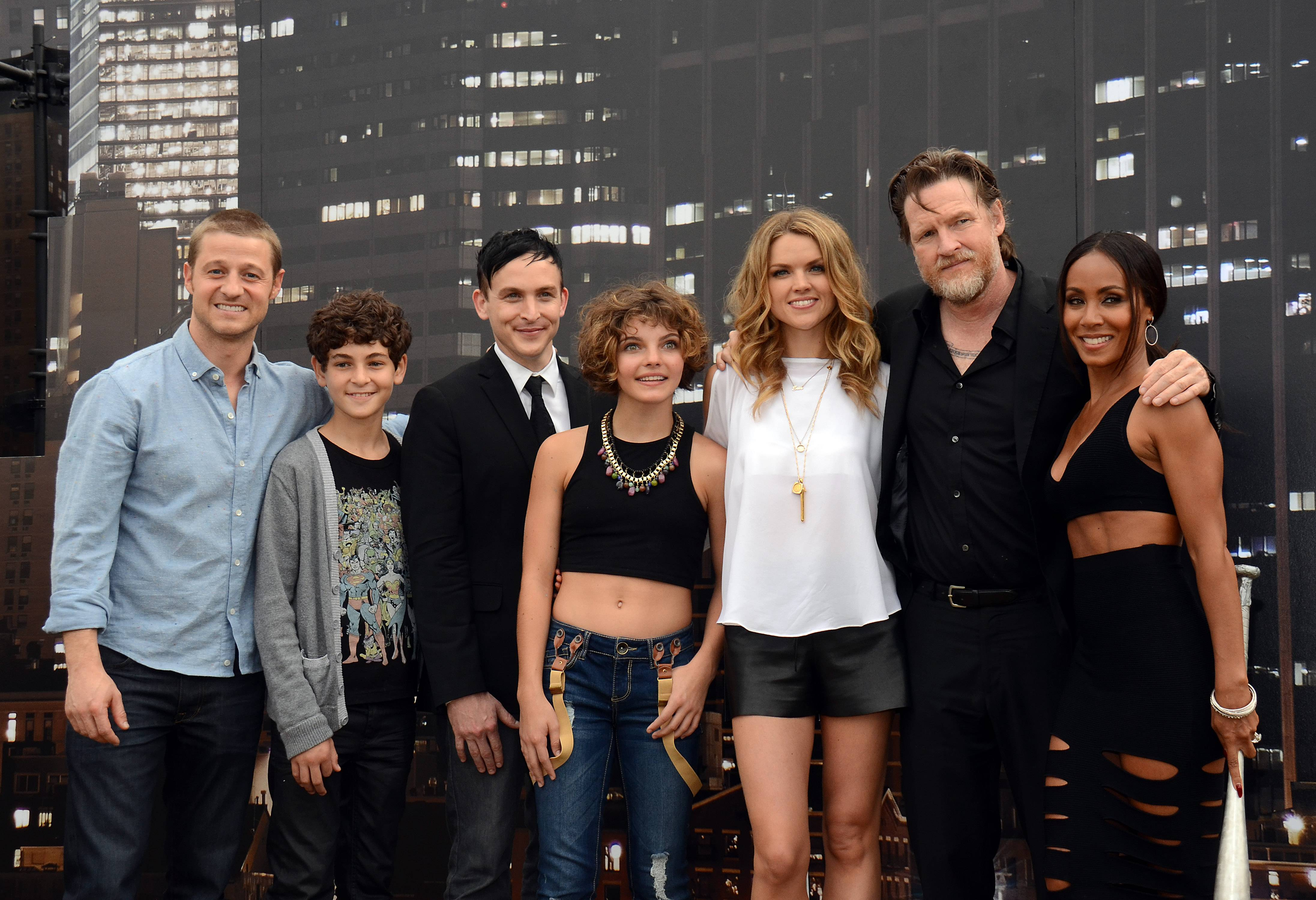"Benjamin McKenzie, from left, David Mazouz, Robin Taylor, Camren Bicondova, Erin Richards, Donal Logue, and Jada Pinkett Smith pose at the ""Gotham"" press line on Day 3 of Comic-Con International on Saturday."