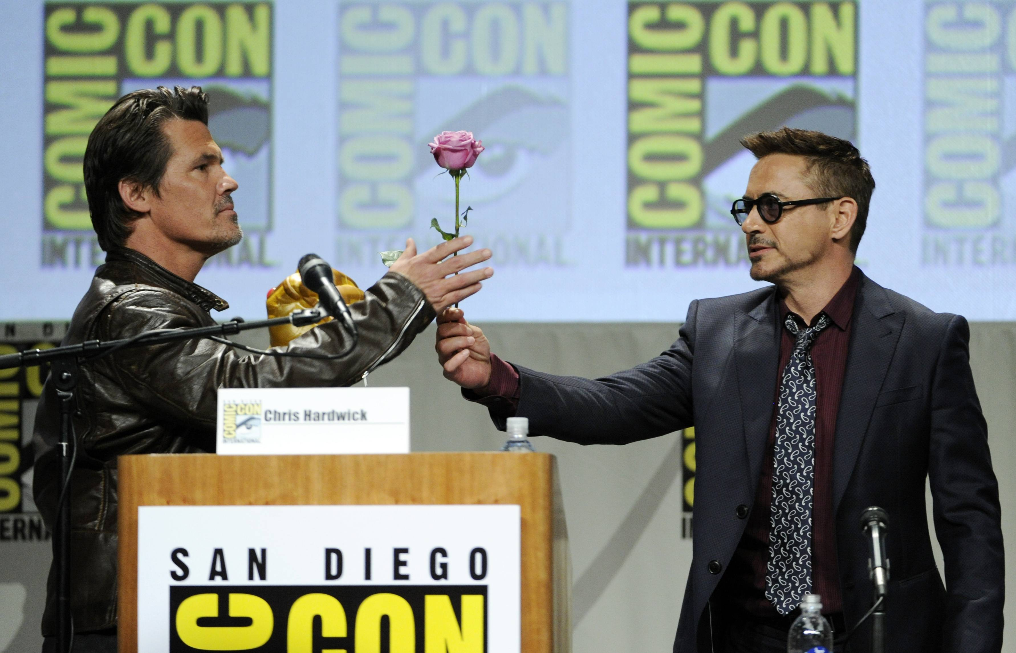 Robert Downey Jr., right, hands Josh Brolin a flower during the Marvel panel at Comic-Con International on Saturday.