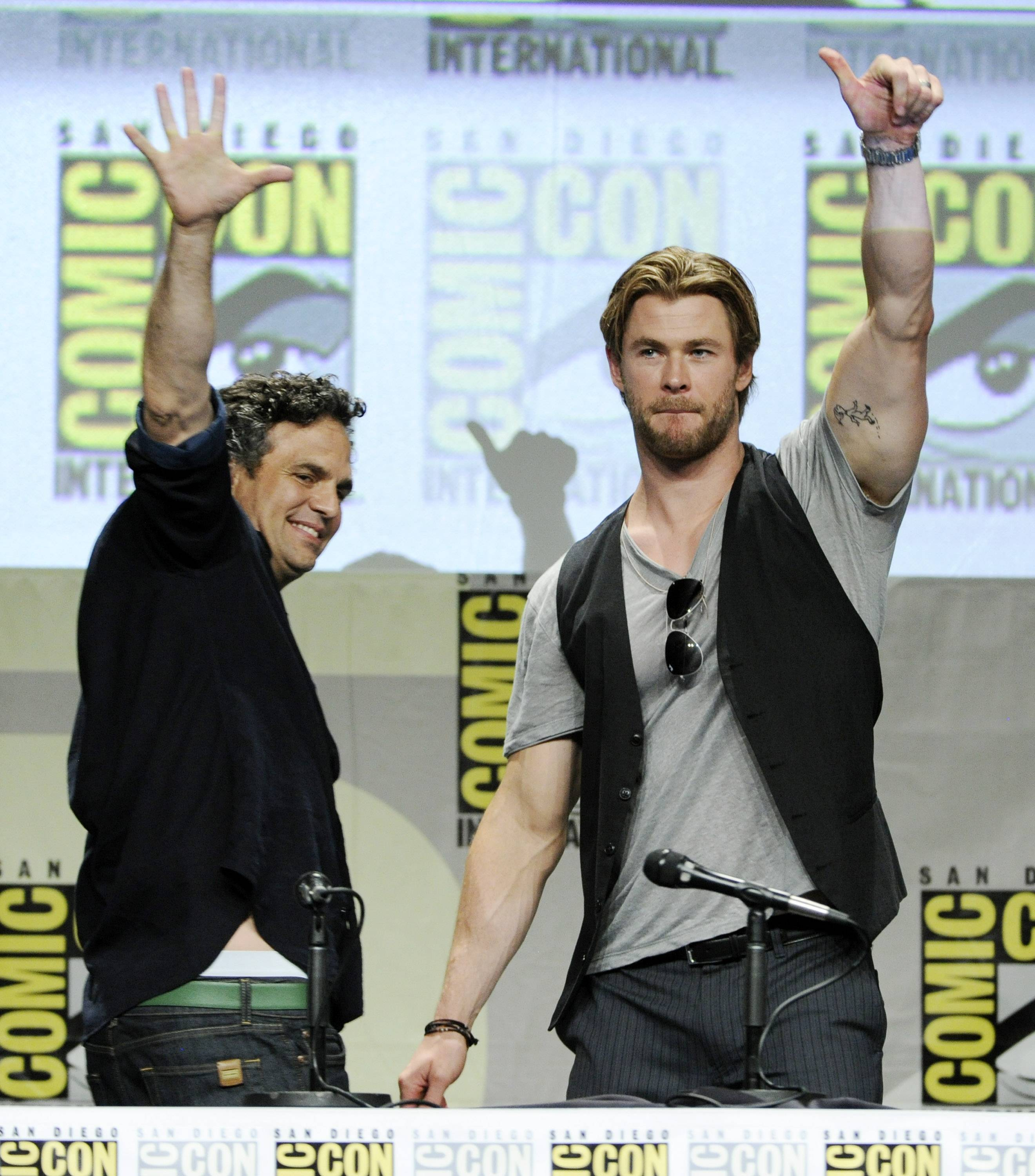 Actors Mark Ruffalo, left, and Chris Hemsworth acknowledge the crowd at the end of the Marvel panel at Comic-Con International on Saturday.