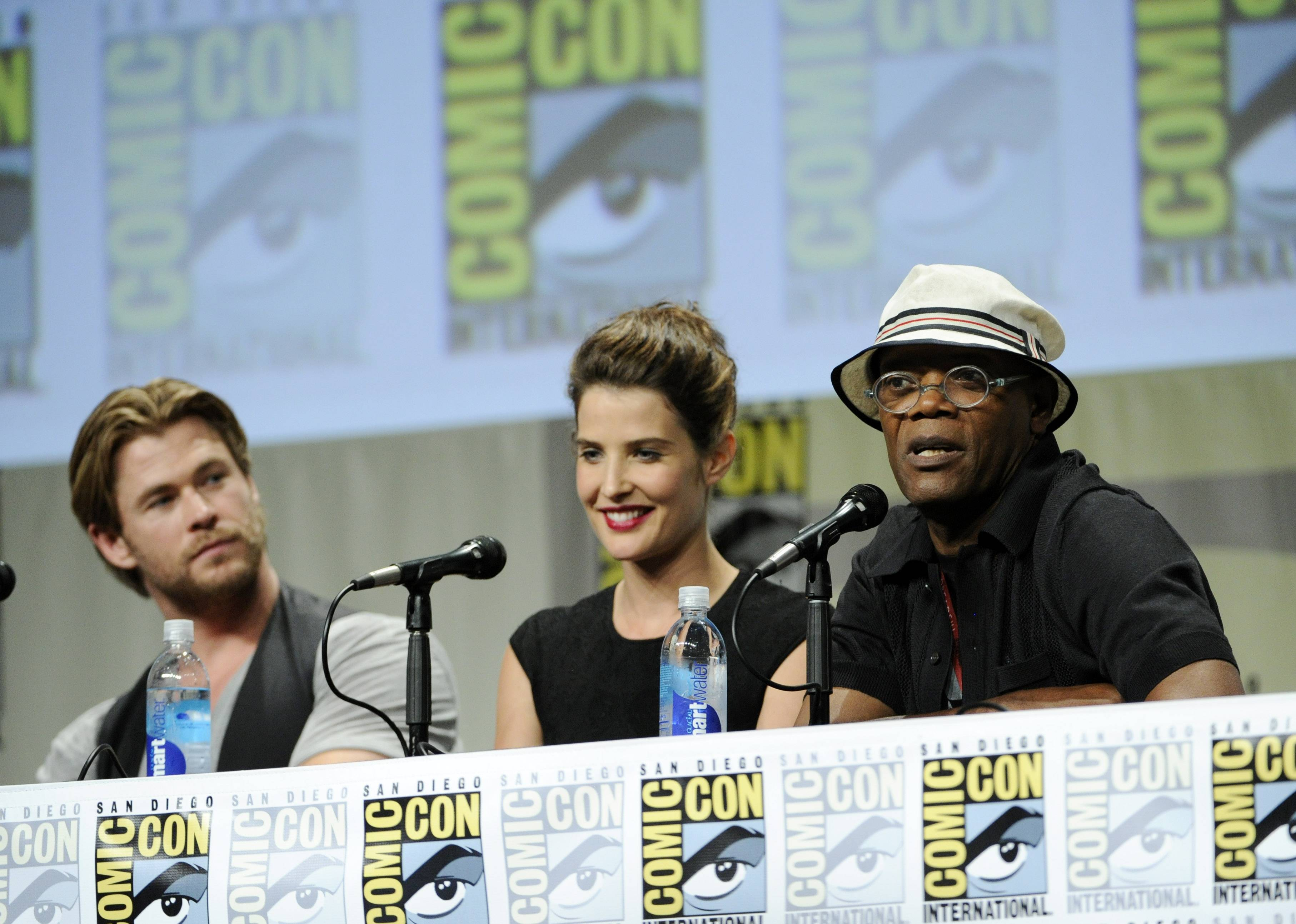 Actor Samuel L. Jackson, right, answers a question as fellow actors Chris Hemsworth, left, and Cobie Smulders sit near during the Marvel panel at Comic-Con International on Saturday in San Diego.