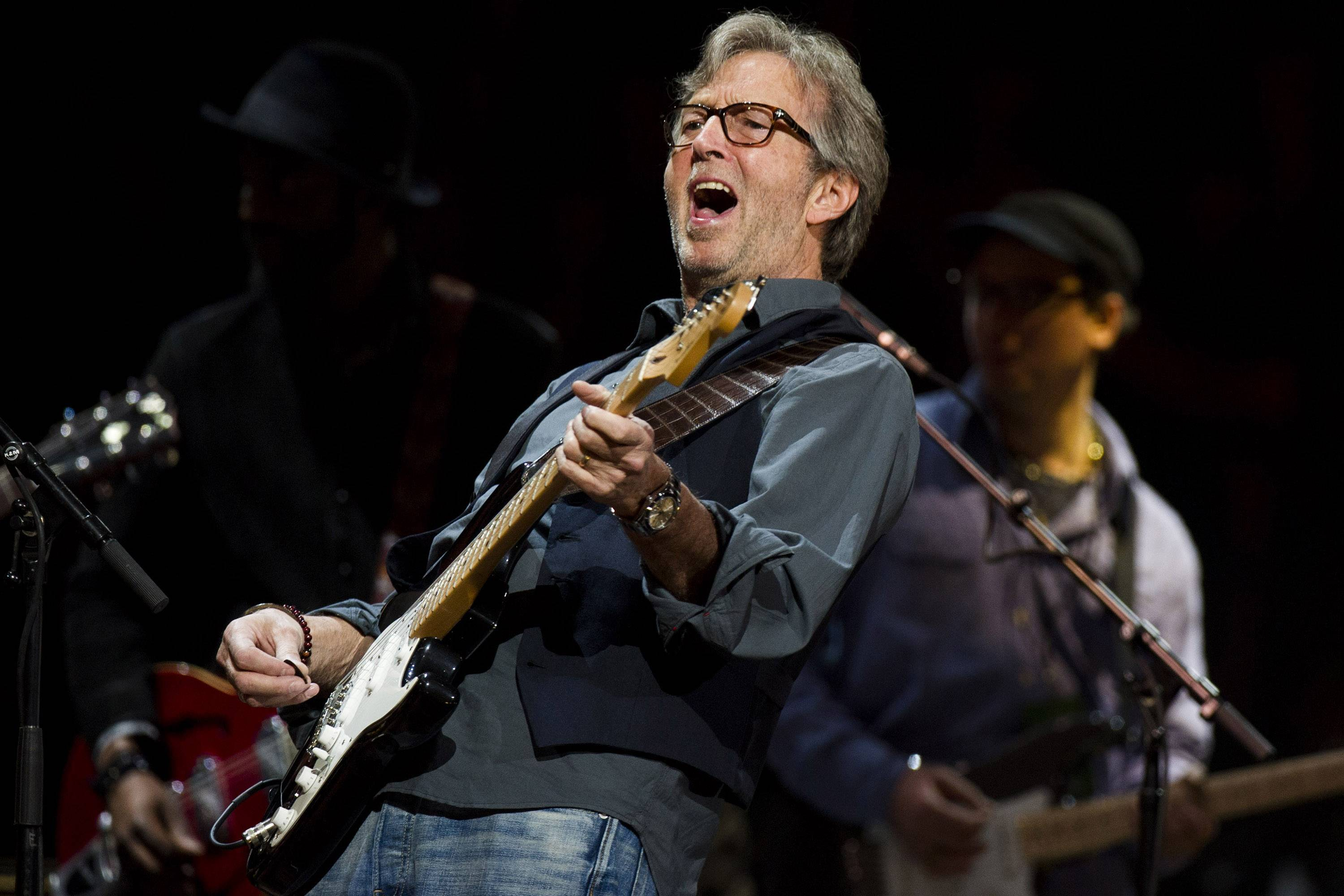 Eric Clapton performs at Madison Square Garden in New York. Clapton says singer-songwriter JJ Cale rescued him and gave him a direction.