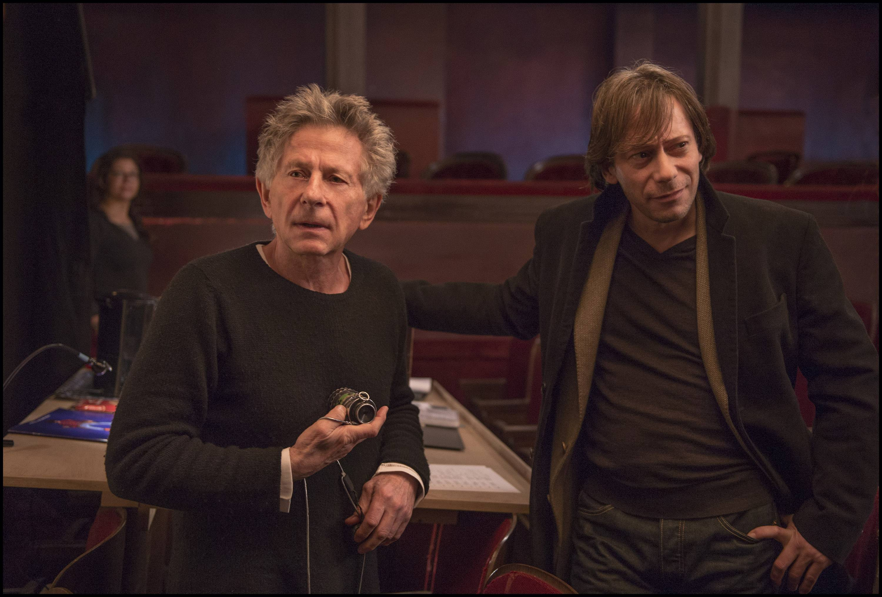 "Director Roman Polanski, left, and Mathieu Amalric as Thomas behind the scenes in Polanski's recent film, ""Venus in Fur."""
