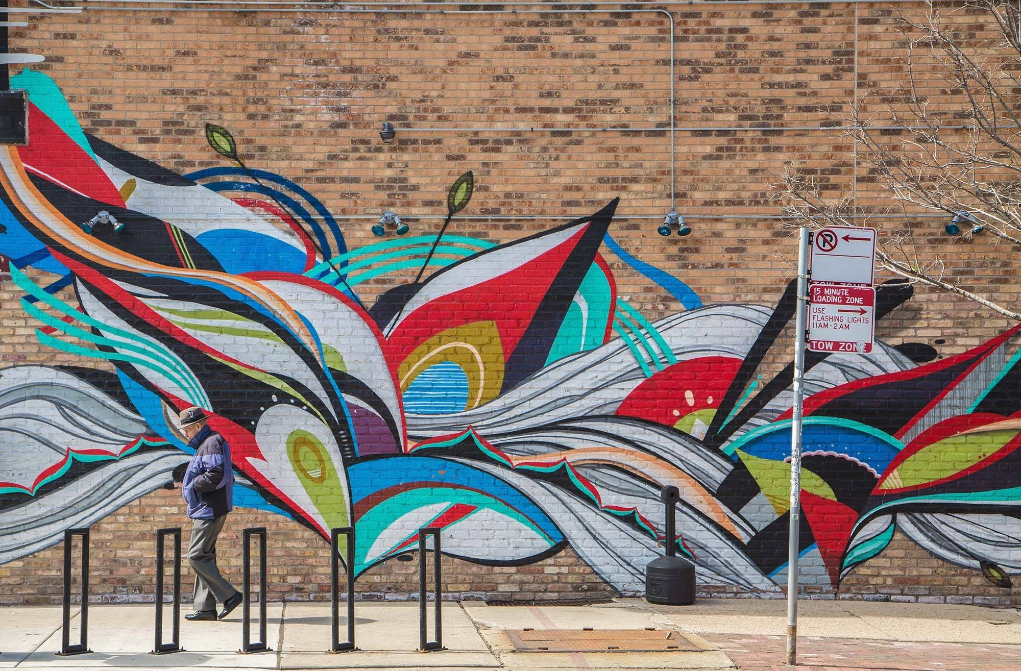 A mural by Ruben Aguirre decorates Simone's Bar in Chicago's Pilsen neighborhood three miles southwest of Chicago's downtown.
