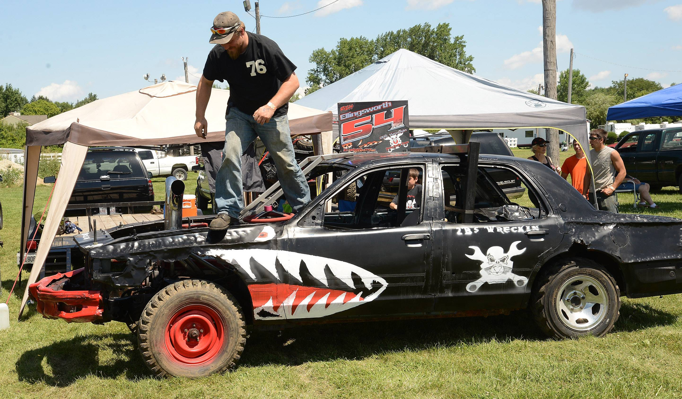 Bradley Ellingsworth of Plainfield gets his car ready for the demolition derby Sunday on the final day at the DuPage County Fair.