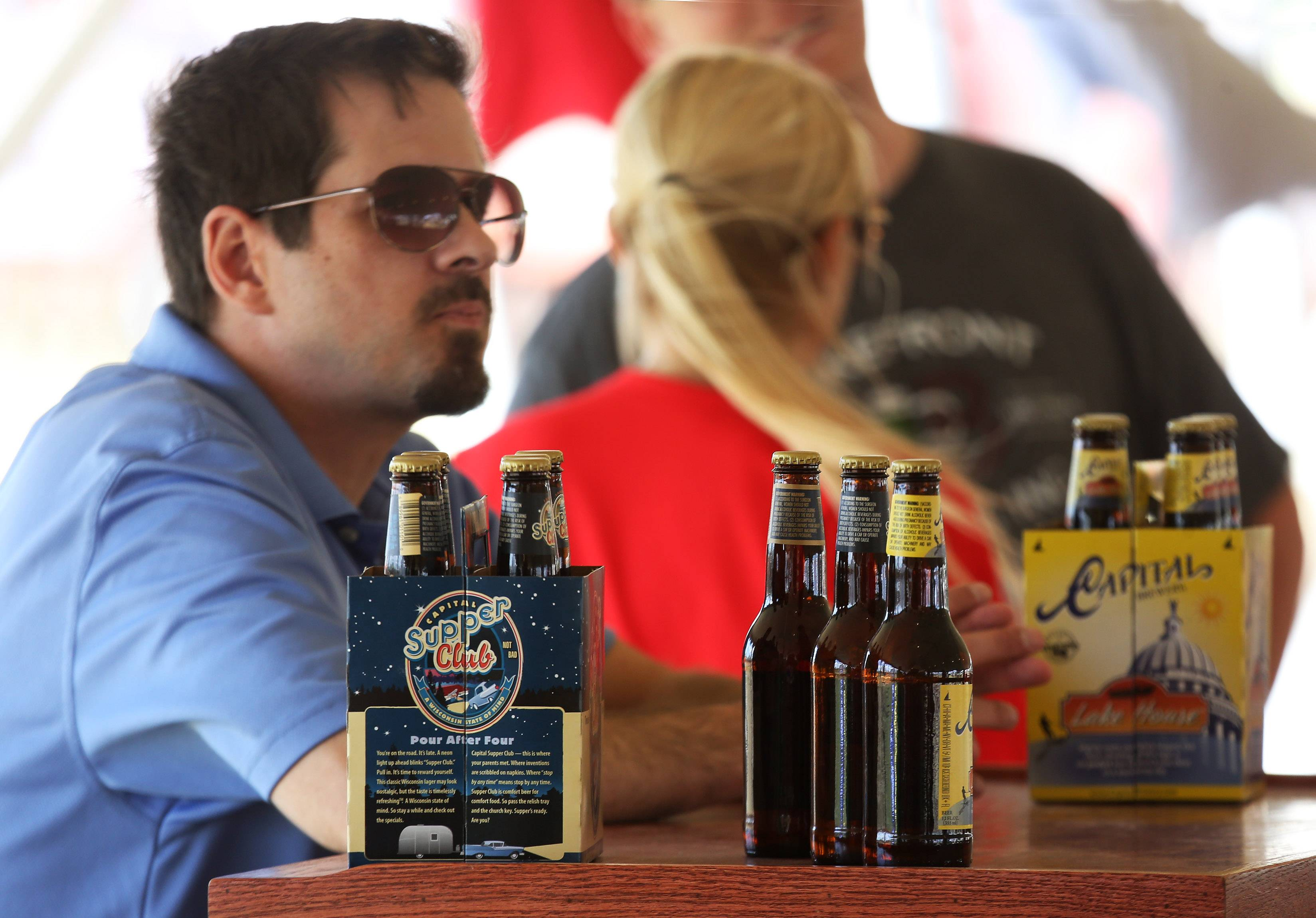 Jason Danielson of Capital Brewery Co. talks with beer enthusiasts during Sunday's first Craft Beer Festival at the Lake County Fair in Grayslake.