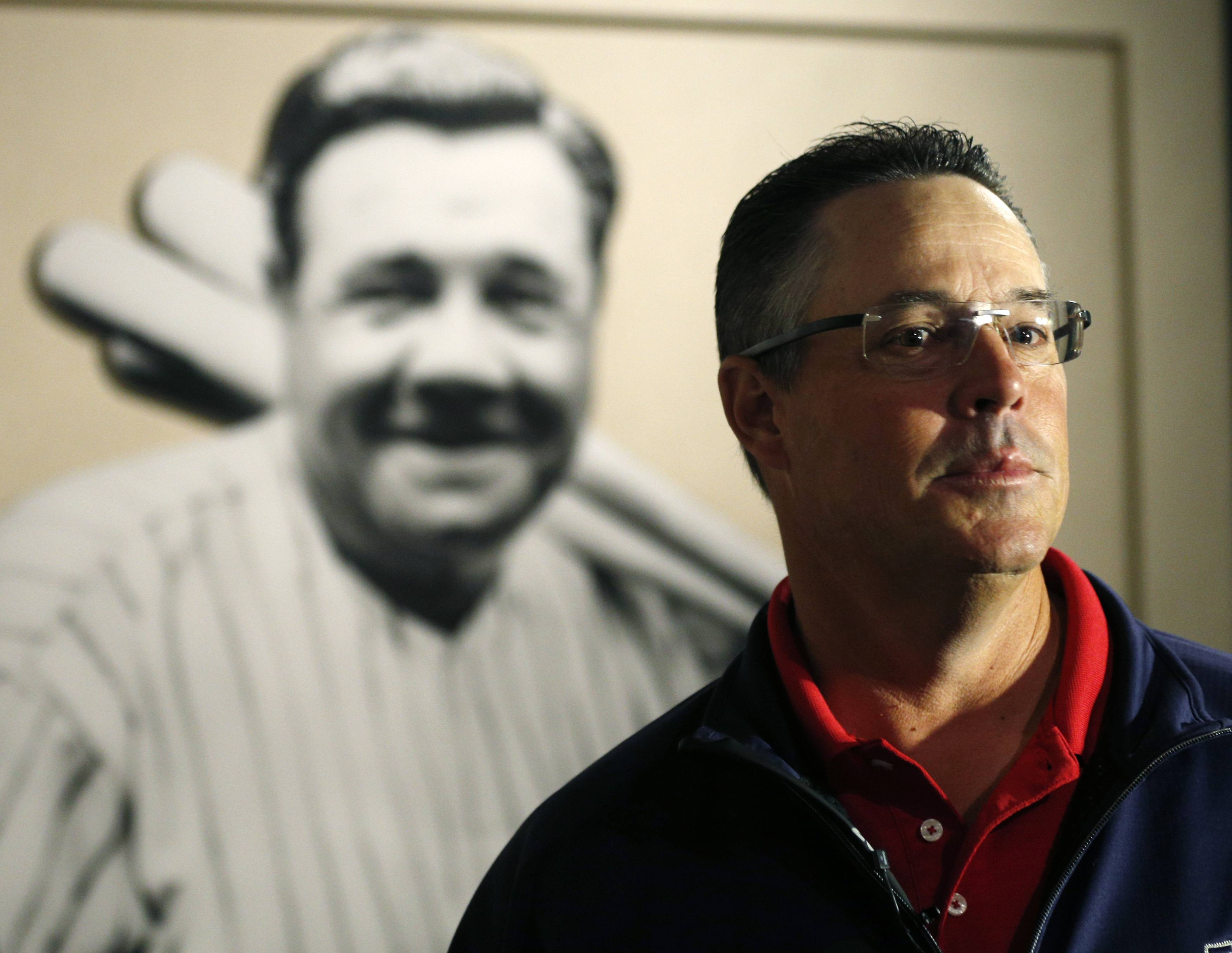 Ex-Cubs pitcher Greg Maddux visits a Babe Ruth exhibit during his orientation visit at the Baseball Hall of Fame last March in Cooperstown, N.Y.