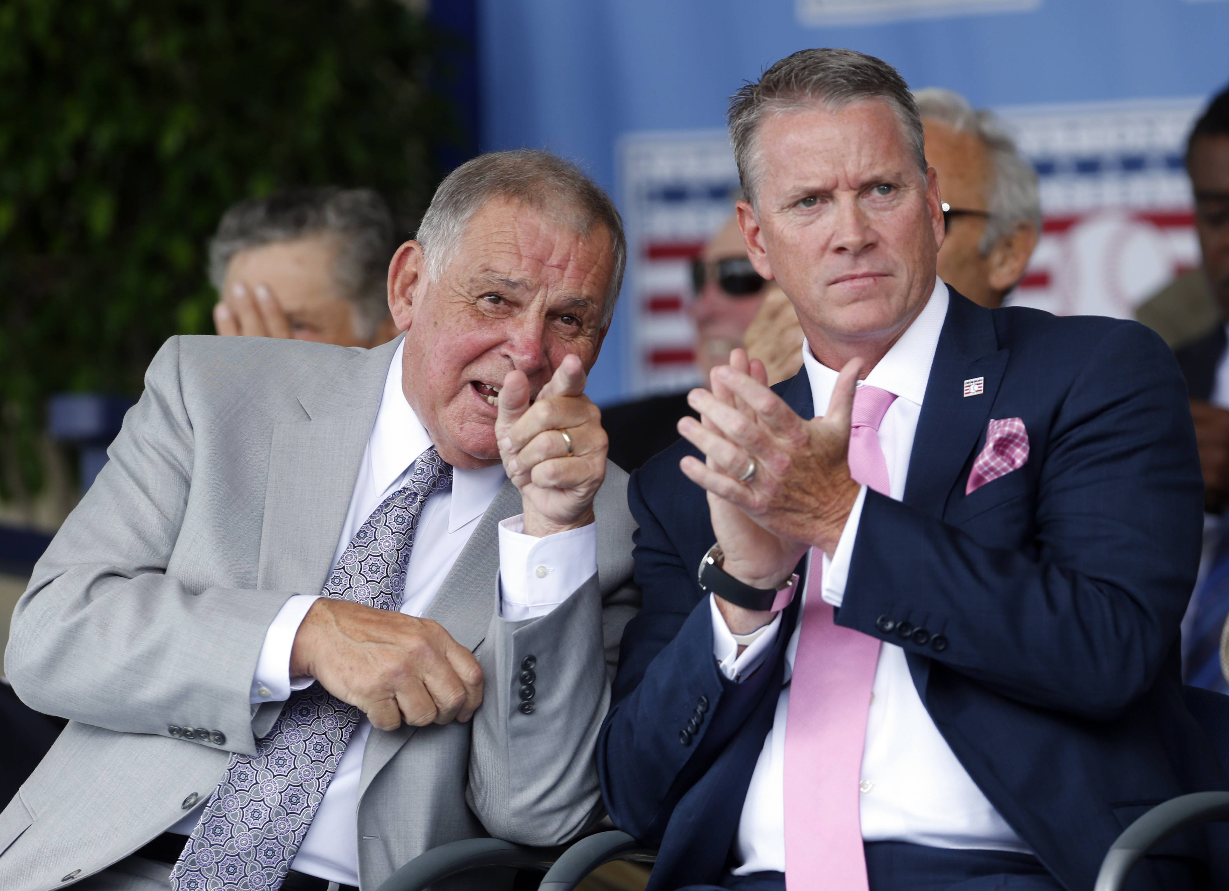 National Baseball Hall of Fame inductees Bobby Cox, left, and Tom Glavine talk during an induction ceremony at the Clark Sports Center on Sunday.