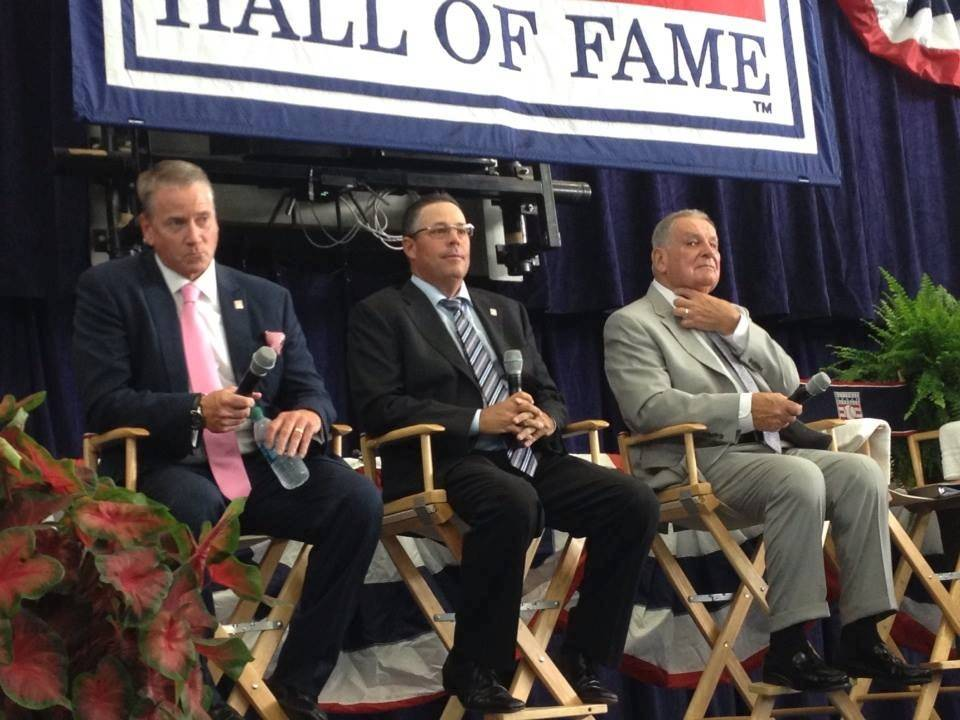 Former Cubs pitching great Greg Maddux, center, takes in the spectacle of Cooperstown on Sunday with fellow Hall of Fame inductees -- and Atlanta Braves World Series winners -- Tom Glavine, left, and Bobby Cox.