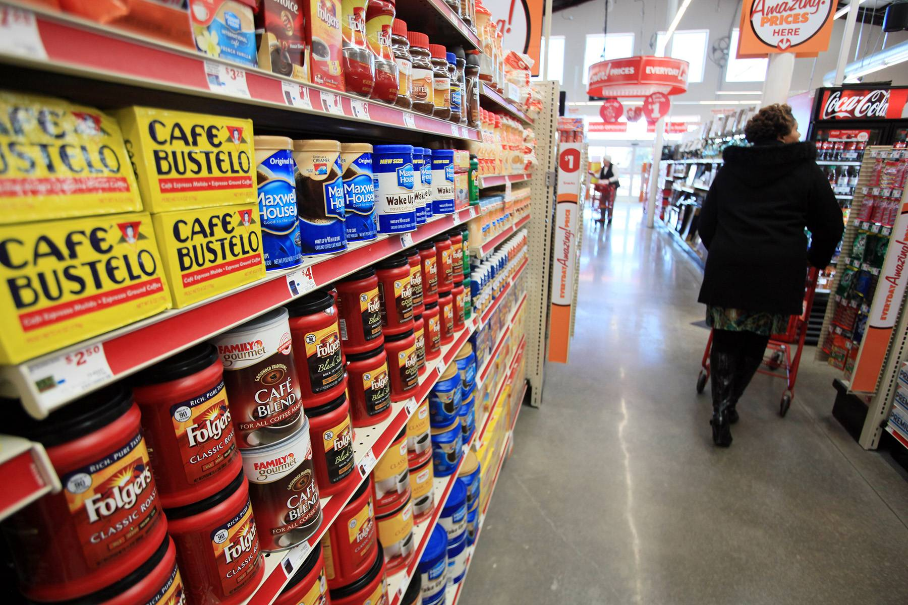 A shopper browses an aisle at a Family Dollar Stores Inc. in Mansfield Texas. ollar Tree is buying rival discount store Family Dollar in a cash-and-stock deal valued at about $8.5 billion.