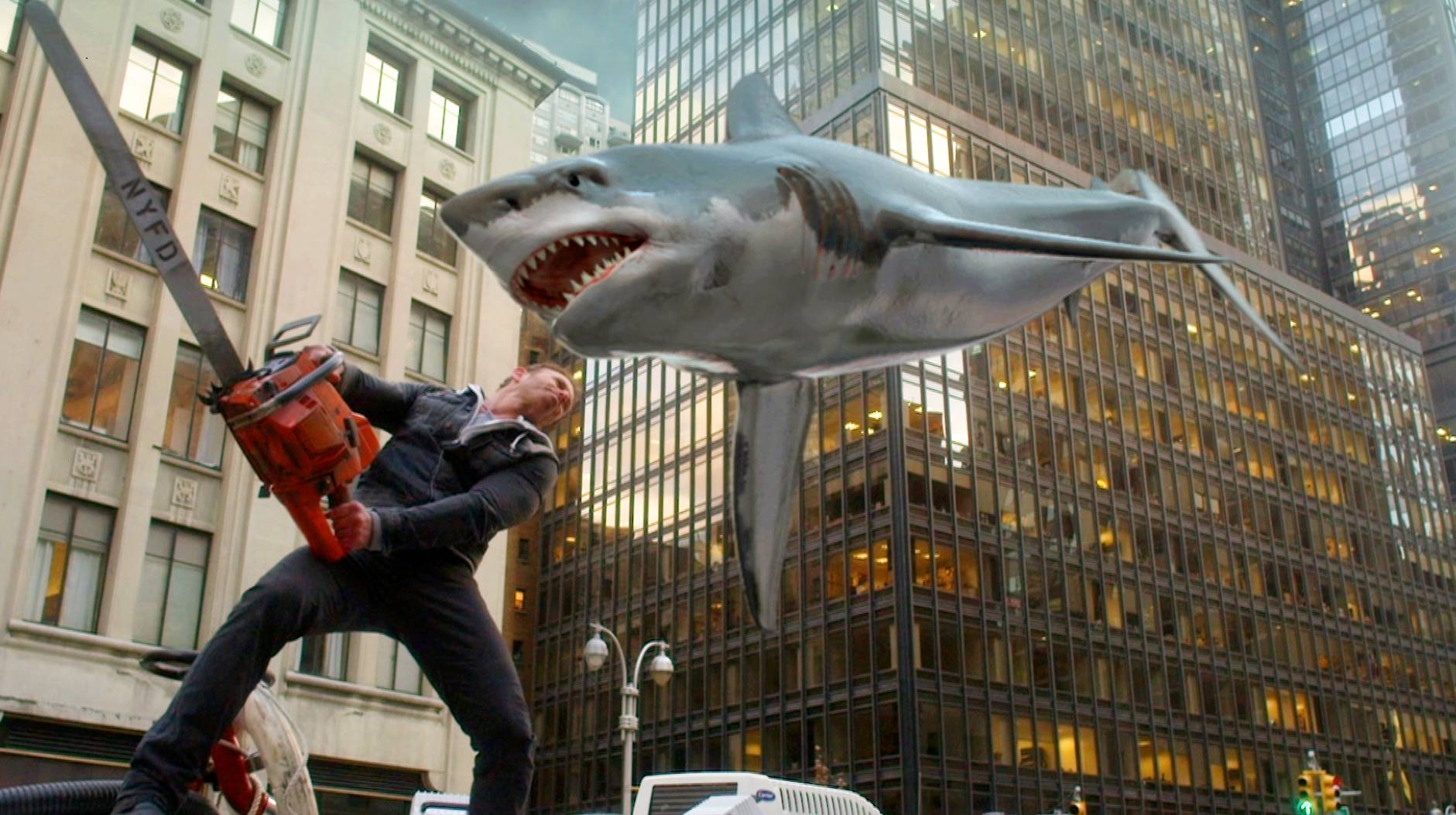 "Ian Ziering, as Fin Shepard, battles a shark on a New York City street in a scene from ""Sharknado 2: The Second One,"" premiering at 8 p.m. Wednesday on the Syfy network."