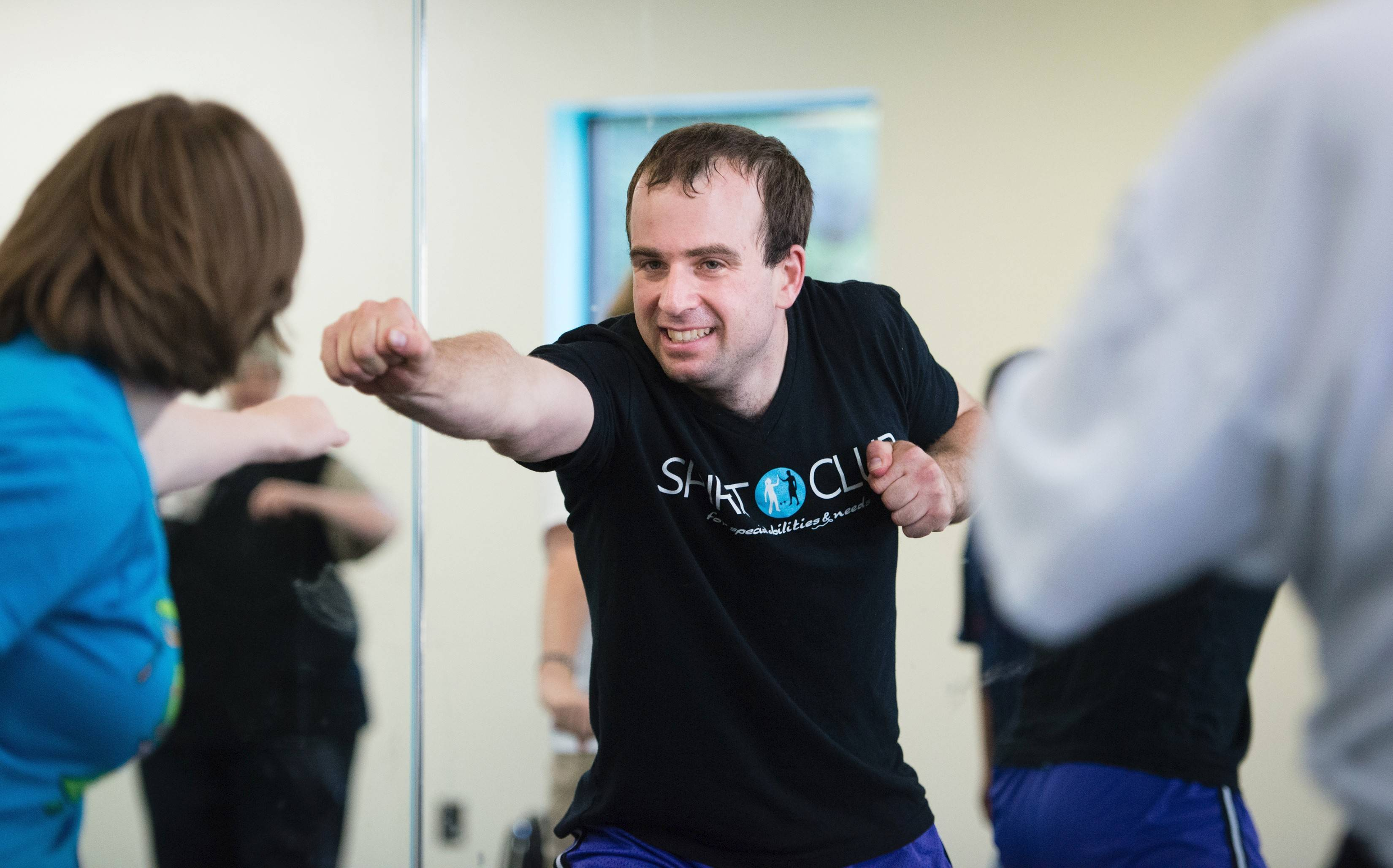 Sam Smith leads a workout. Smith, an exercise instructor and certified personal trainer, also has autism.