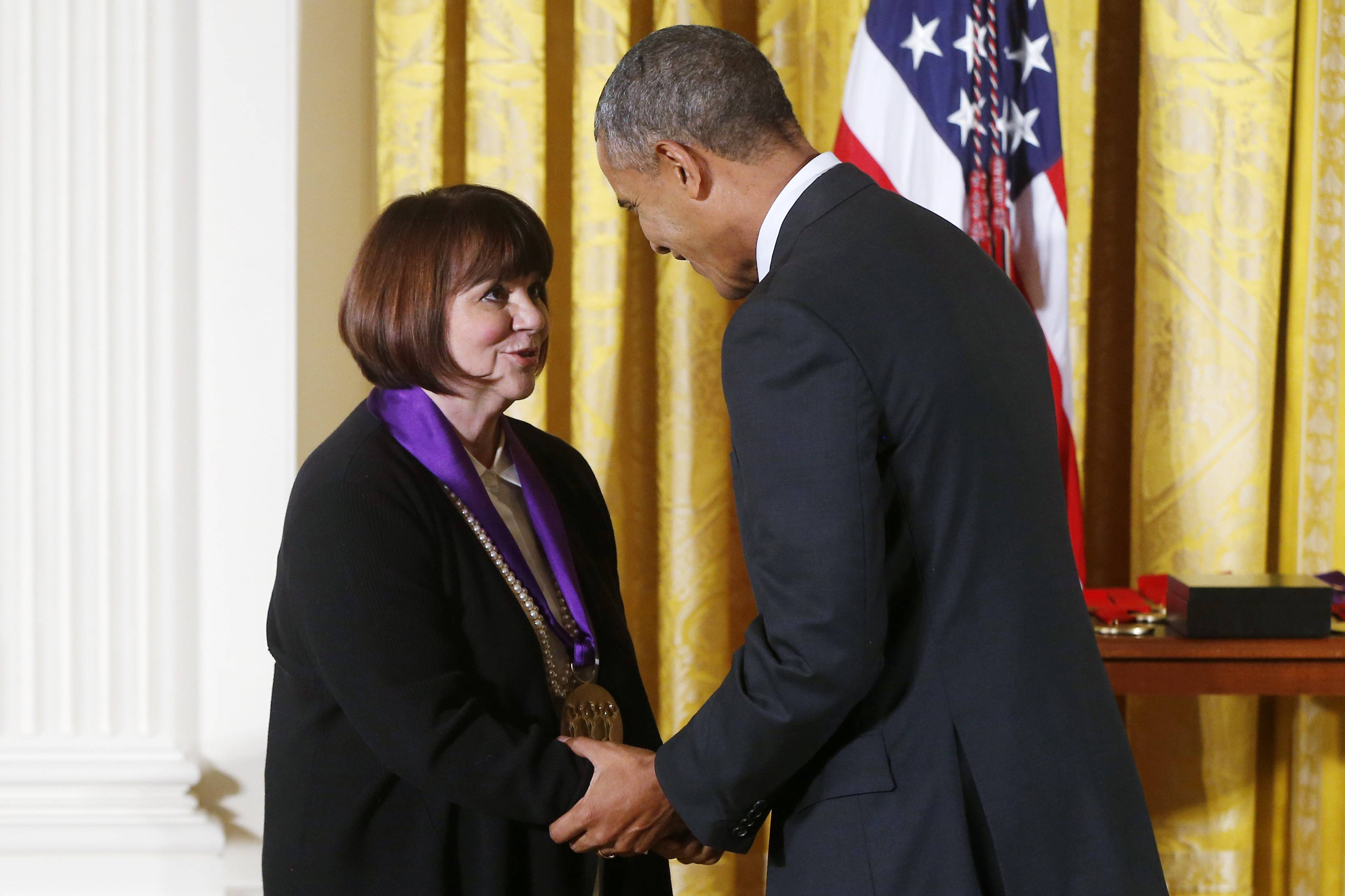 President Obama greets musician Linda Ronstadt in the East Room of the White House, where he presented her with a 2013 National Medal of Arts.