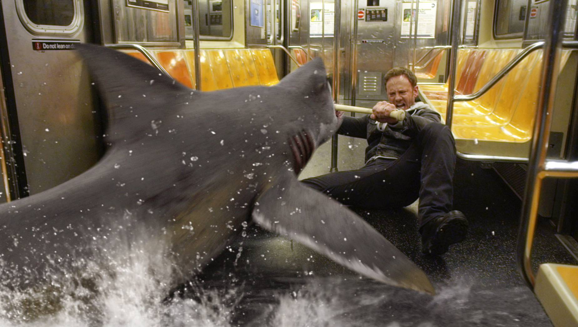 "Ian Ziering, as Fin Shepard battles a shark on a New York City subway in a scene from ""Sharknado 2: The Second One,"" premiering at 8 p.m. Wednesday on the Syfy network."