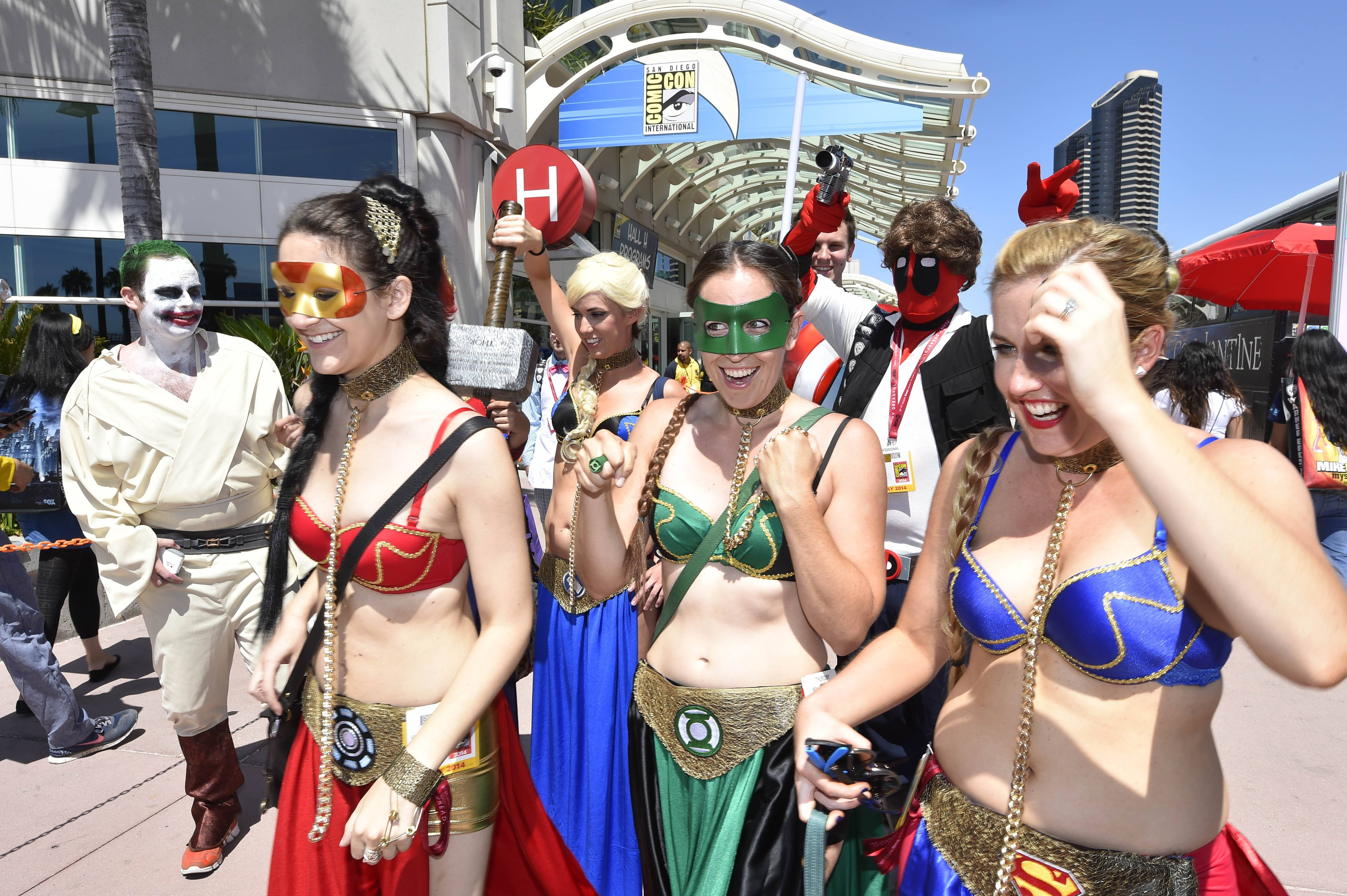 Costumed characters walk outside of the convention center on day 1 of the 2014 Comic-Con International Convention Thursday. Geeks for CONsent, founded by three women from Philadelphia, gathered nearly 2,600 signatures on an online petition supporting a formal anti-harassment policy at Comic-Con.