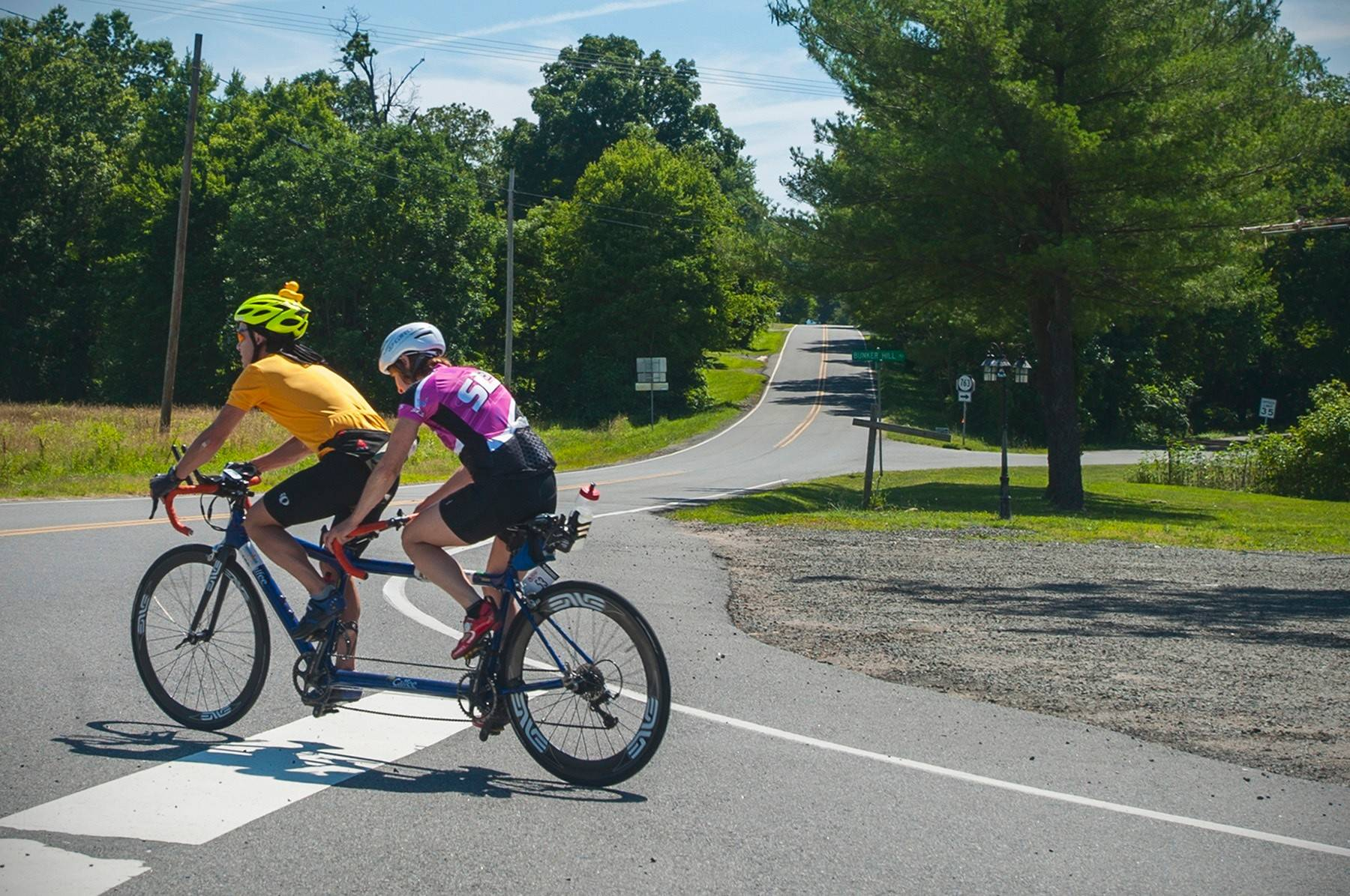 Kevin Streeter, left, guides Tina Ament during a training ride. Ament, who is blind, is training for the Ironman Triathlon in Hawaii.