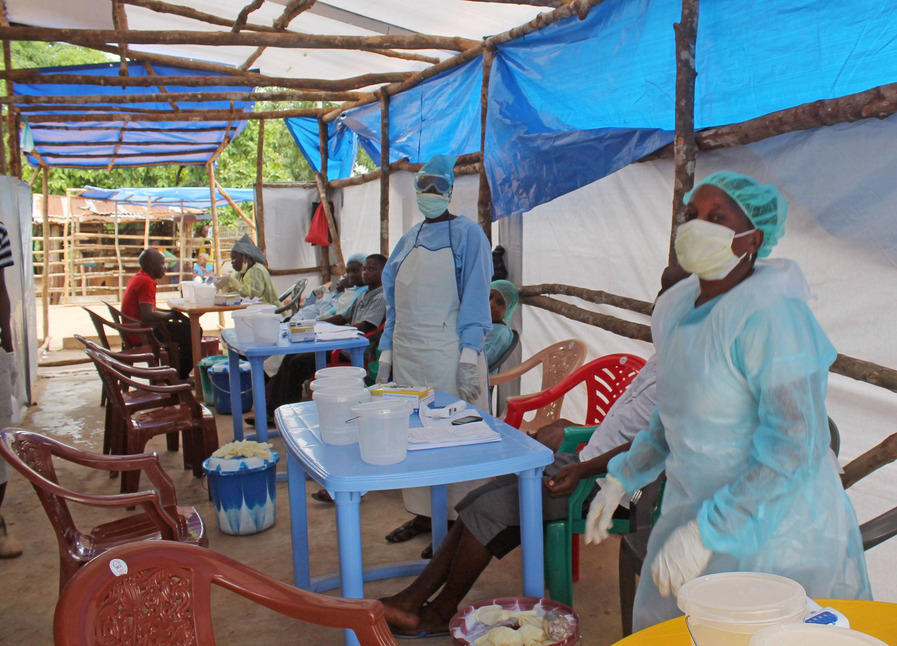 In this photo taken on Sunday, medical personnel work inside a clinic taking care of Ebola patients on the outskirts of Kenema, Sierra Leone. Liberian President Ellen Johnson Sirleaf has closed some border crossings and ordered strict quarantines of communities affected by the Ebola outbreak.