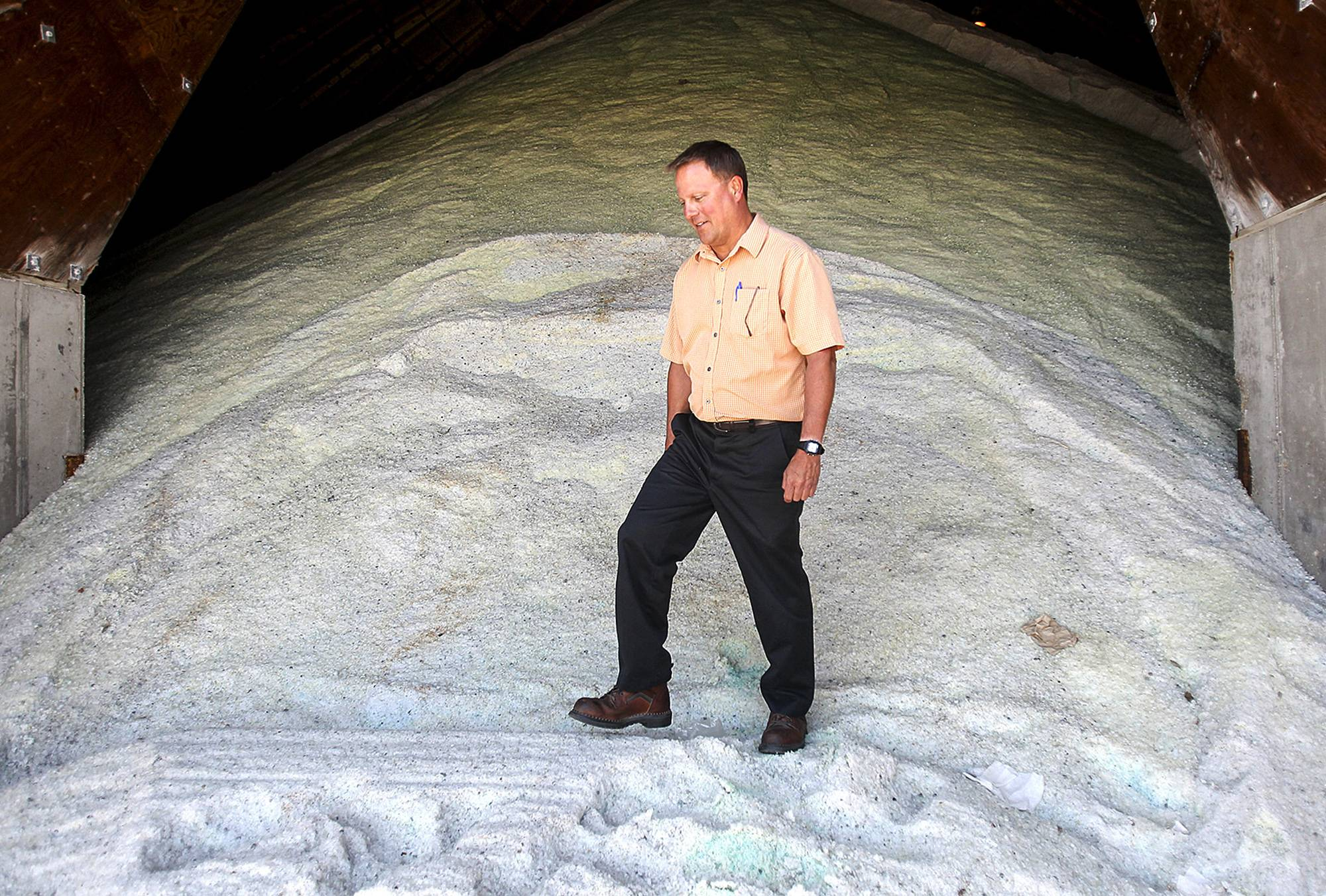 McHenry County Division of Transportation Maintenance Superintendent Edward Markison stands in the salt dome at a facility in Woodstock.
