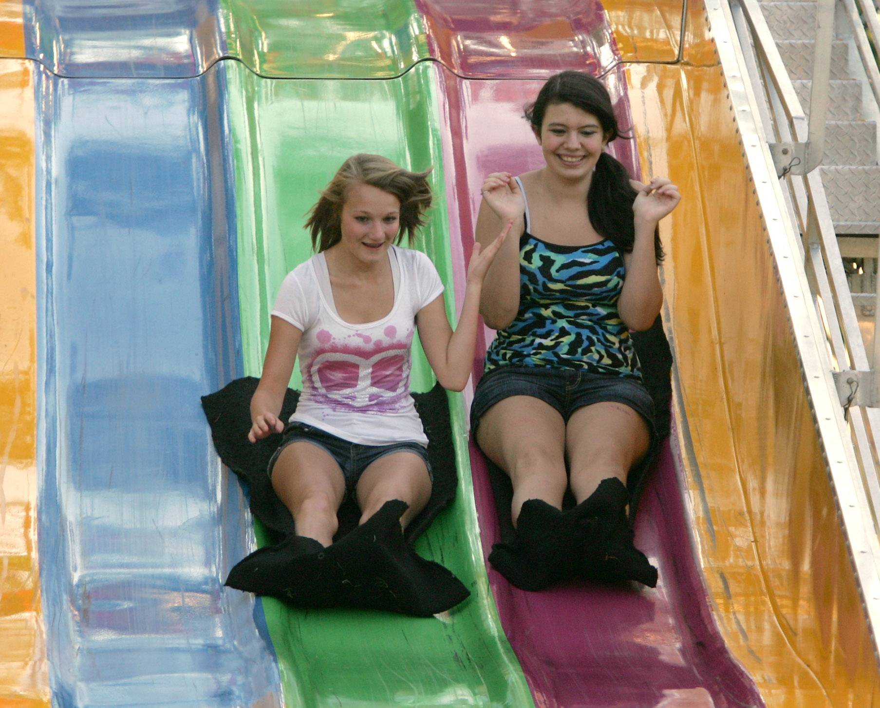 Kimberly Kittelson, left, and Danielle Oliver, both of Lake Villa, slide down the Fun Slide during the first day of a previous Lake Villa Days at Lehmann Park.