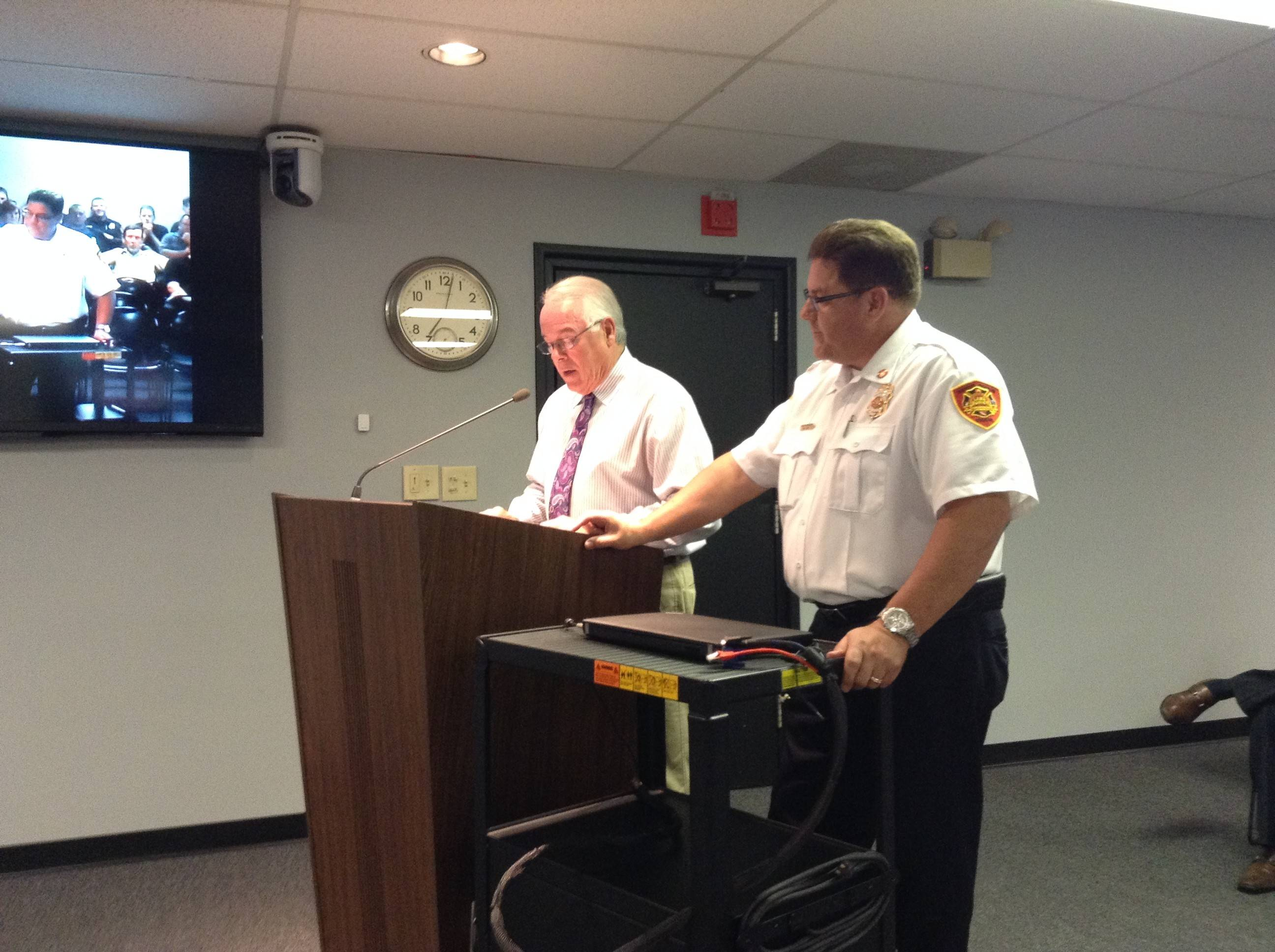 Lake Zurich Fire Chief David Wheelock, right, with Mayor Thomas Poynton, while he was lauded for 35 years of service during a recent village board meeting.