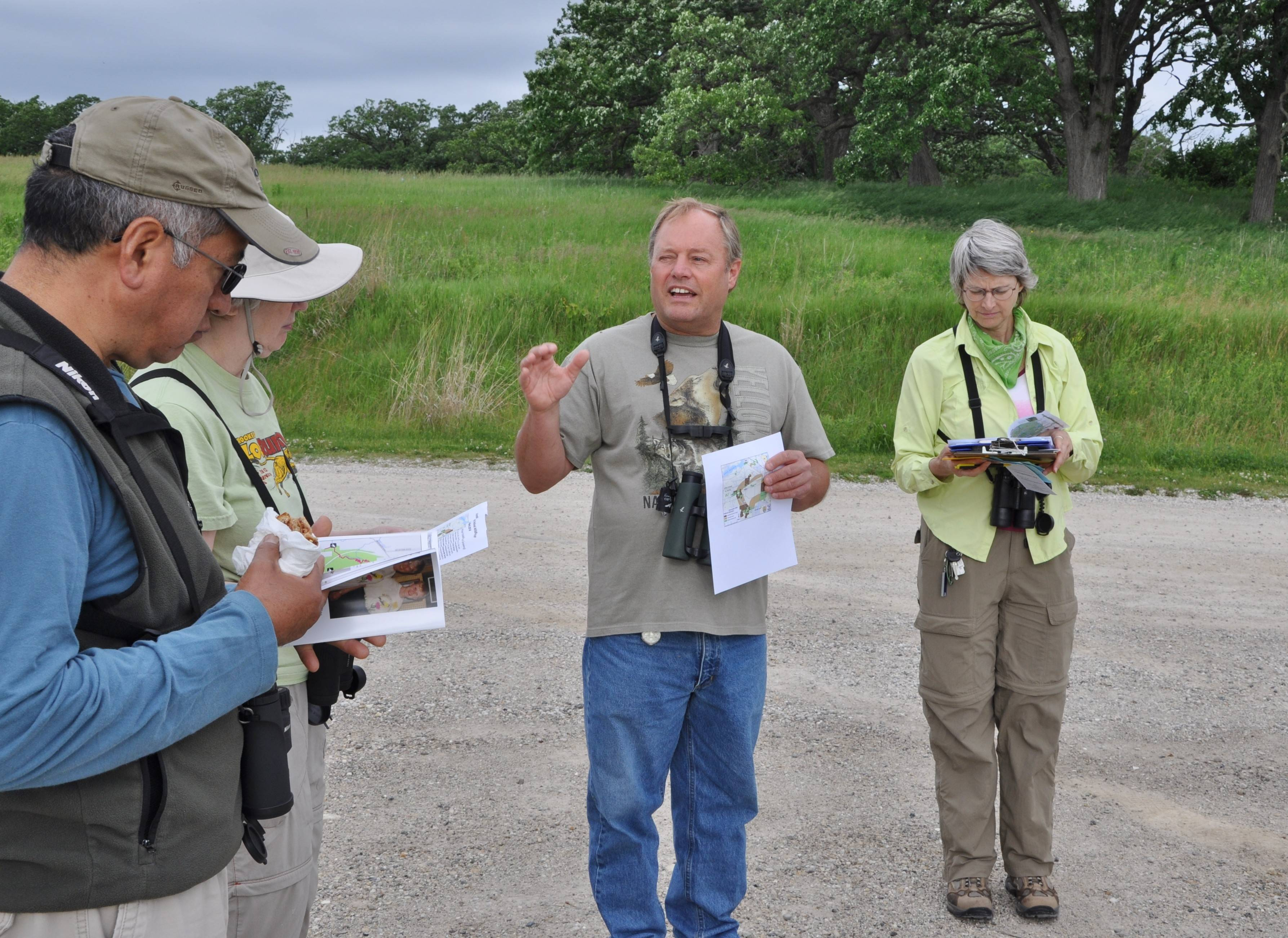 Randy Schietzelt, center, from McHenry County Audubon, gave an overview about Hackmatack National Wildlife Refuge before leading a birding walk. Nancy Tikalsky, right, president of Chicago Ornithological Society, was part of the walk.