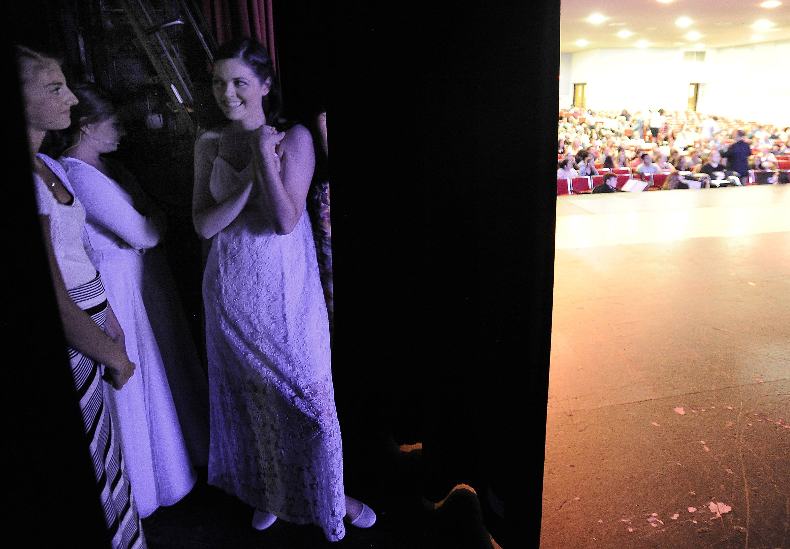 Mark Welsh/mwelsh@dailyherald.comMonica Tipperreiter, playing Lily, stands backstage just before her curtain call all smiles as she finally gets to take the stage in the musical The Secret Garden.  Monica missed her stage debut because of her brain tumor ordeal early in the school year.
