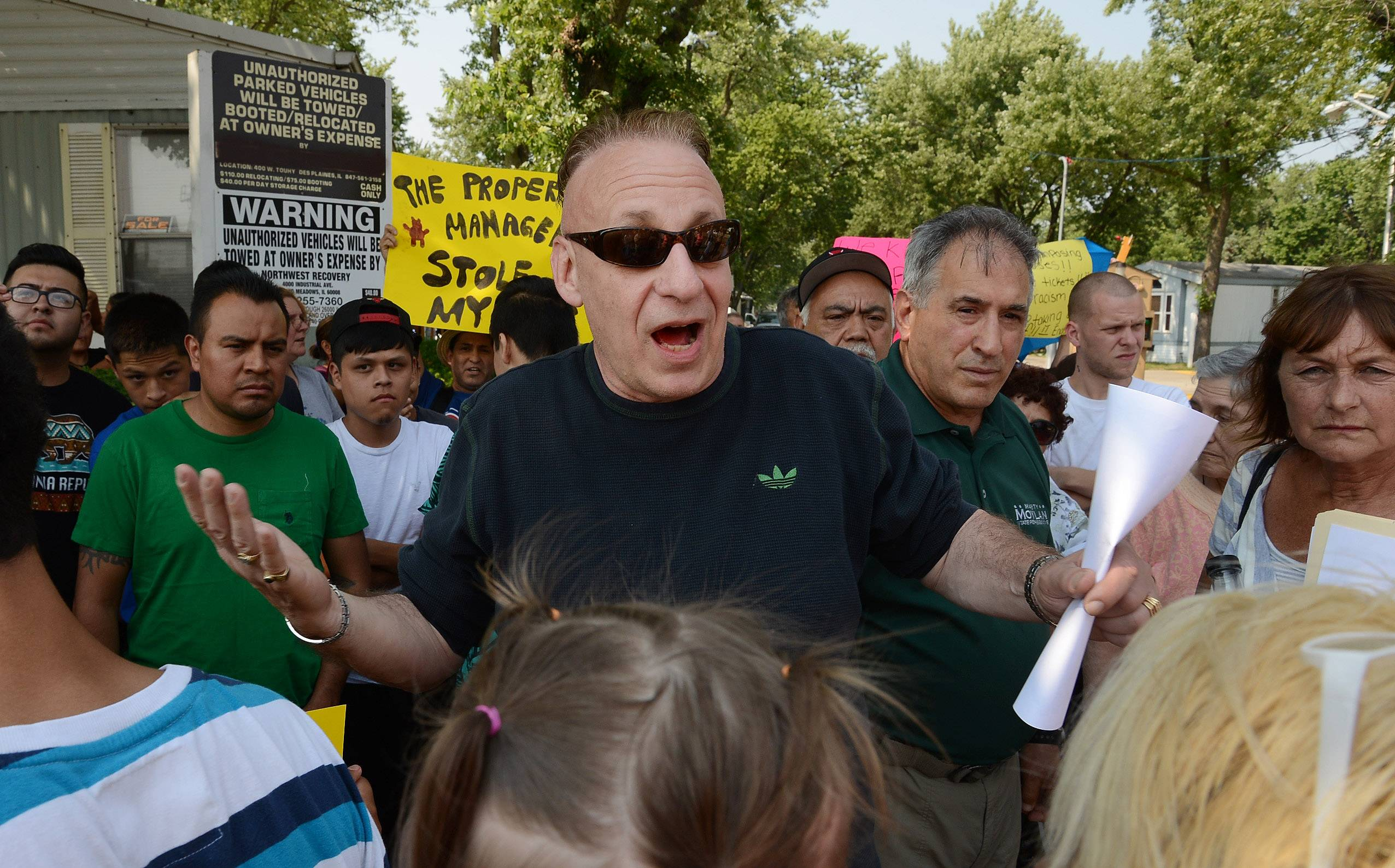 Homeowner/spokesman Stuart Bieber tries to calm angry residents of Blackhawk Estates, in Des Plaines, as they protest management's treatment of residents.