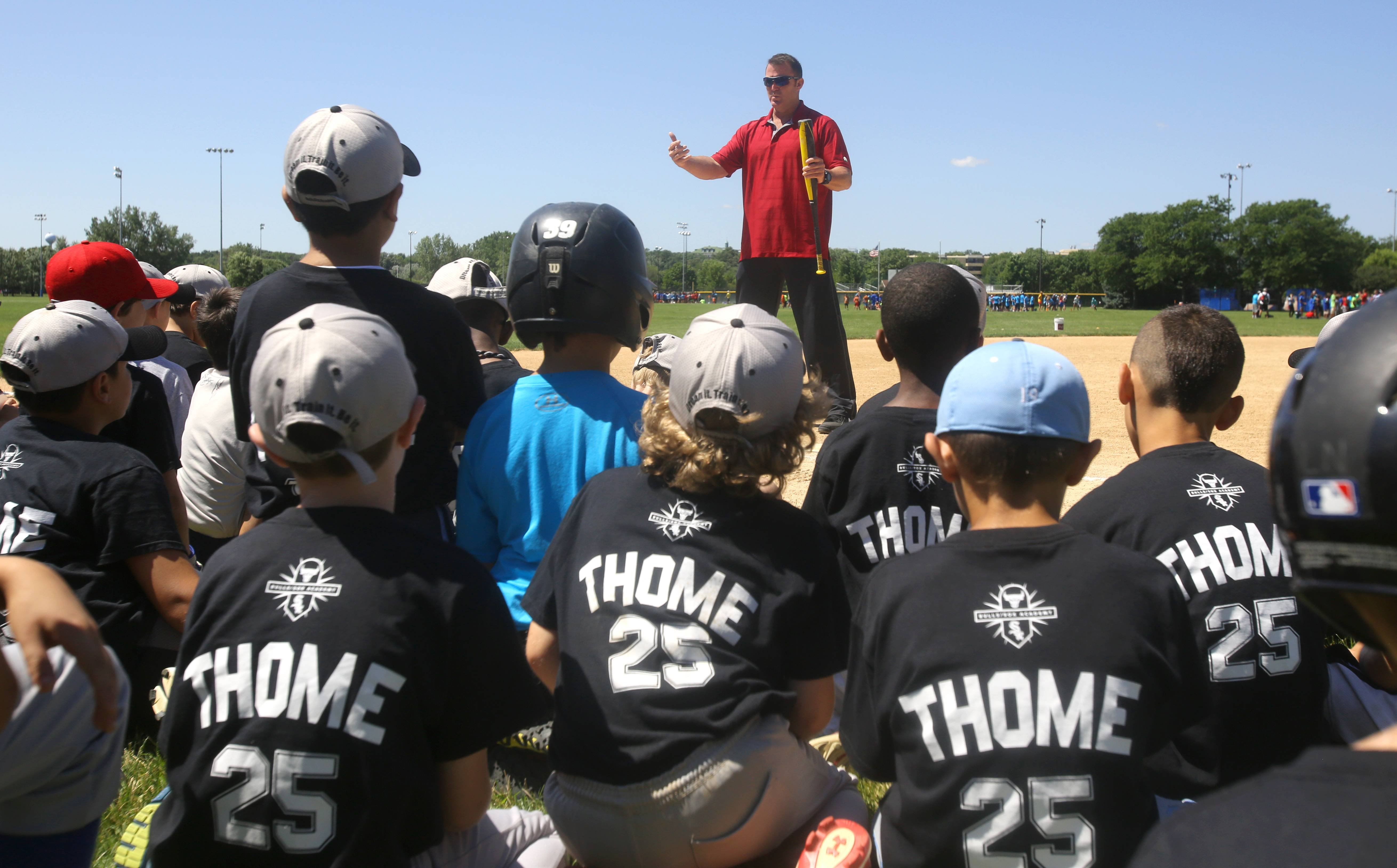 Former major leaguer Jim Thome speaks about a balanced batting stance to participants attending the White Sox Silver Slugger Camp for boys and girls at Lisle's Community Park.