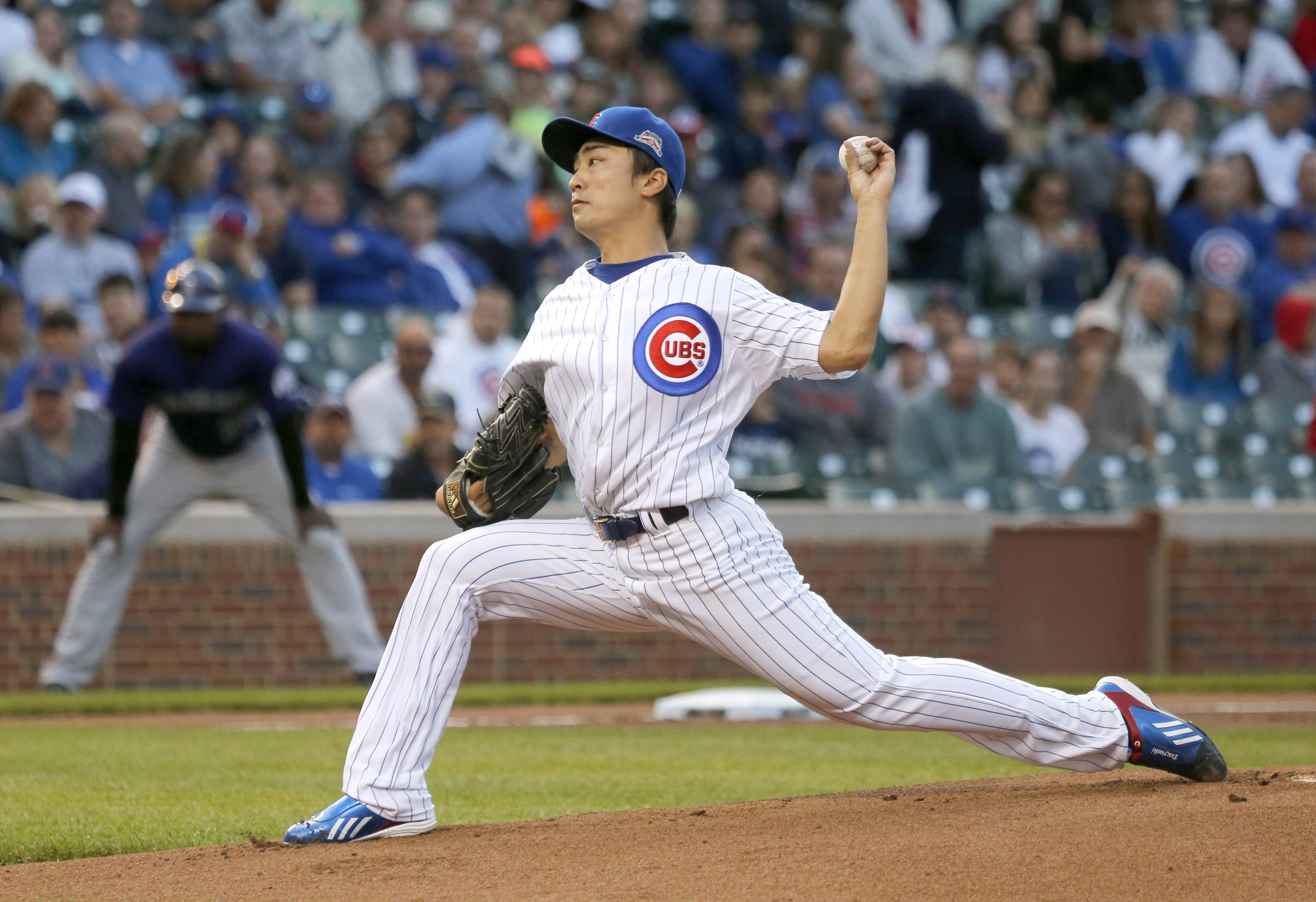 Cubs starting pitcher Tsuyoshi Wada earned his first major-league win Monday night, stopping the Rockies on 5 hits over 7 innings.