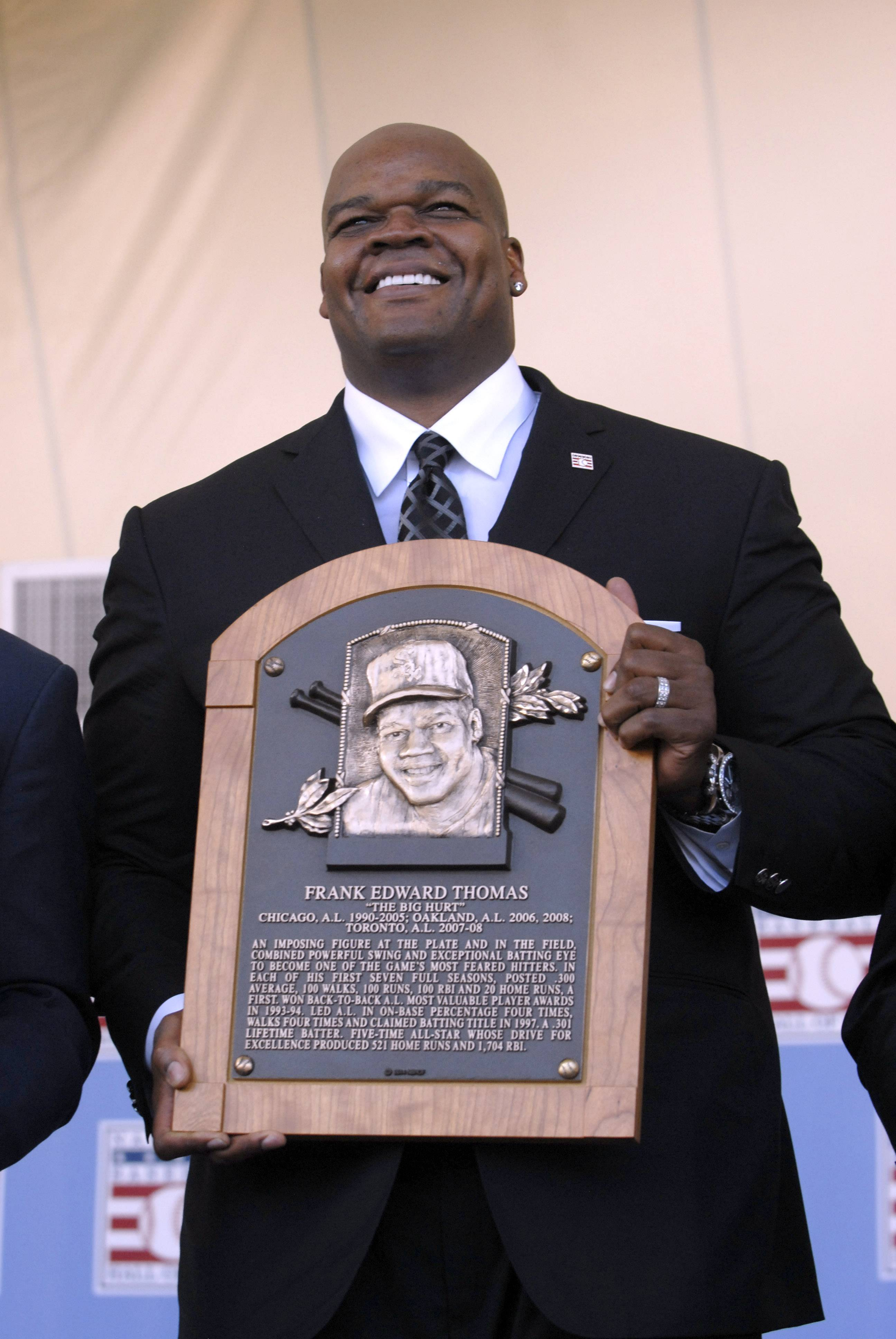 Hall of Famer Bob Gibson had words of praise for newly enshrined Frank Thomas, here holding his plaque during Sunday's induction ceremony, saying he wonders how he would have pitched to the White Sox great.