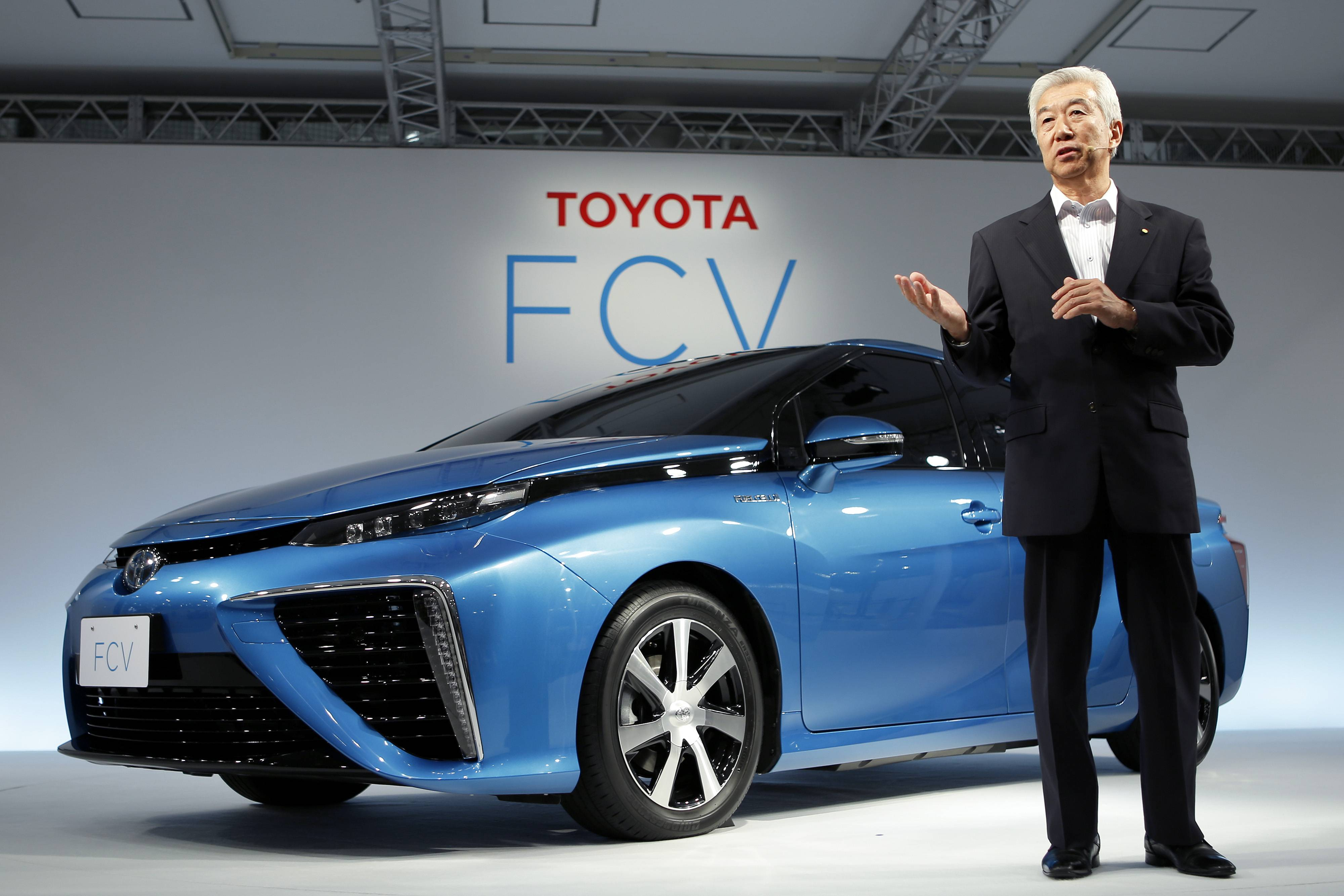 Mitsuhisa Kato, executive vice president at Toyota Motor Corp., speaks as he introduces the company's fuel-cell vehicle (FCV) during a news conference in Tokyo Wednesday.