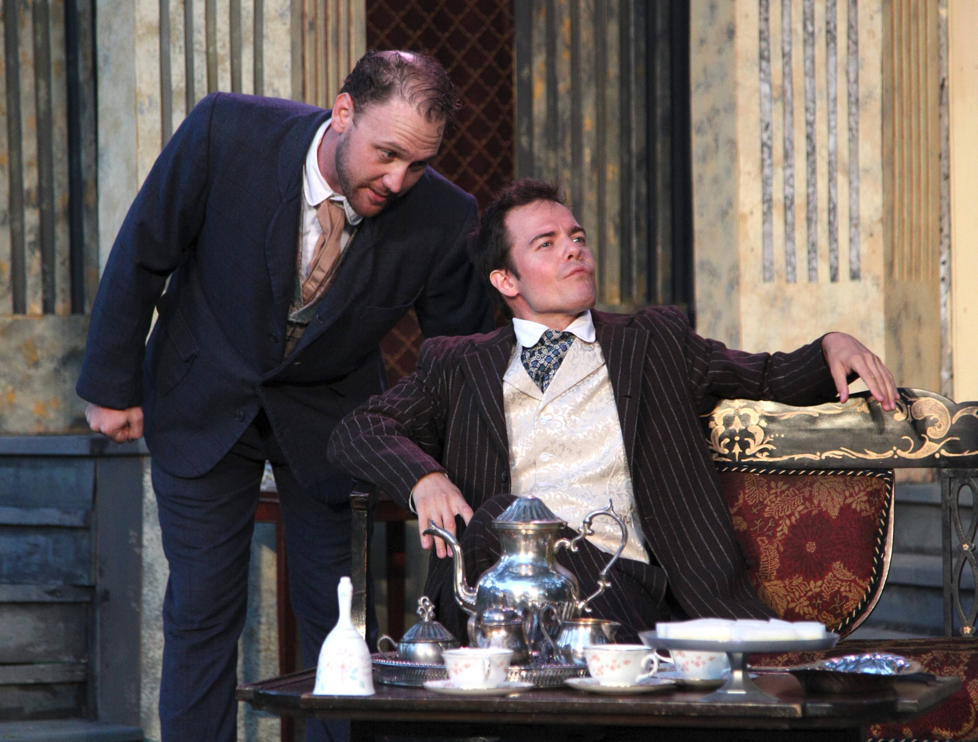 "Jack (John Crosthwaite) shares his plans to marry Gwendolyn with the self-indulgent Algernon (Jude Willis) in Oak Park Festival Theatre's outdoor production of Oscar Wilde's ""The Importance of Being Earnest."""