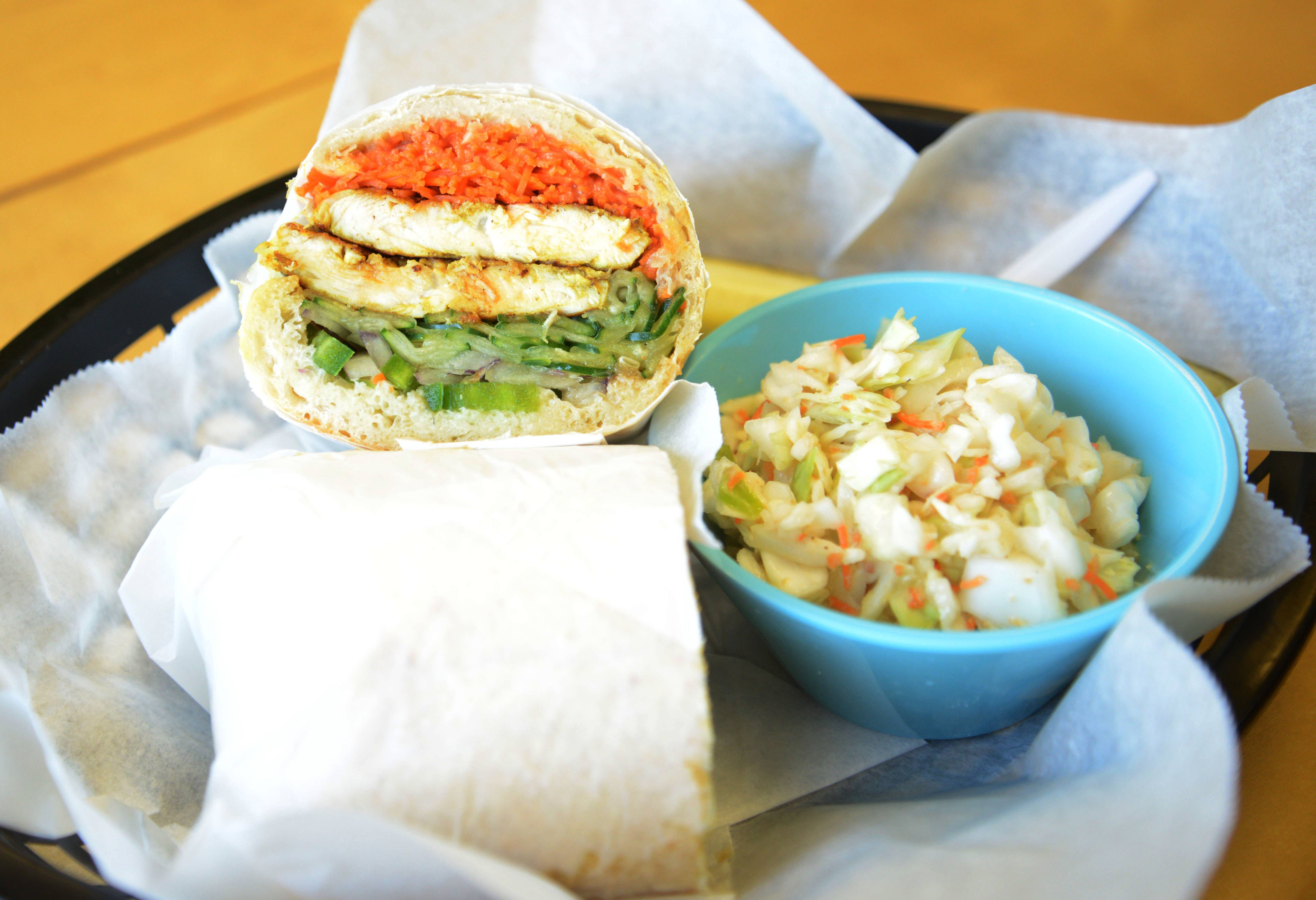The Bryanism sandwich and gingered coleslaw grace a table at Zenwich in Elmhurst.